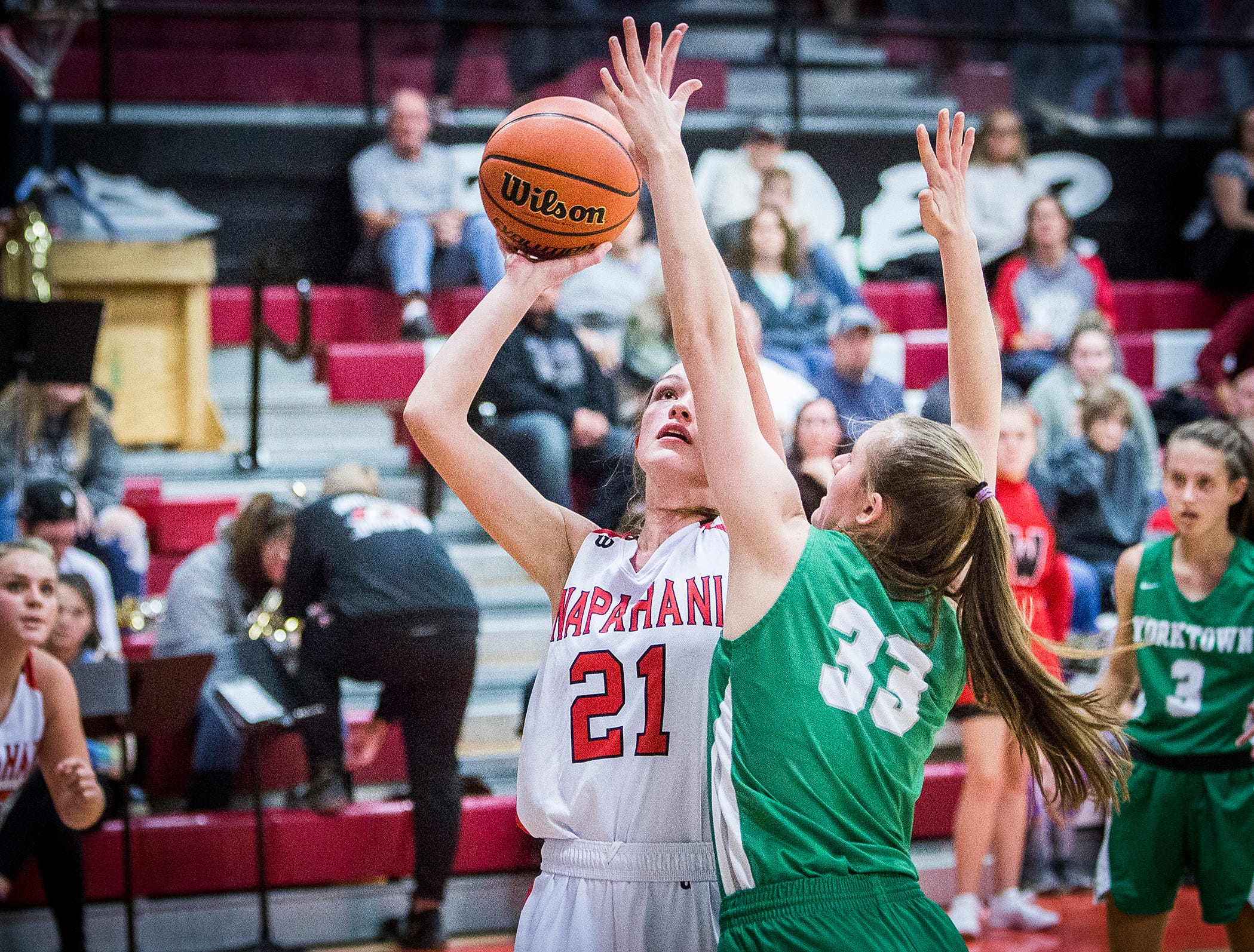 Wapahani's Sydney Cook shoots past Yorktown's defense during their game at Wapahani High School Tuesday, Dec. 4, 2018.