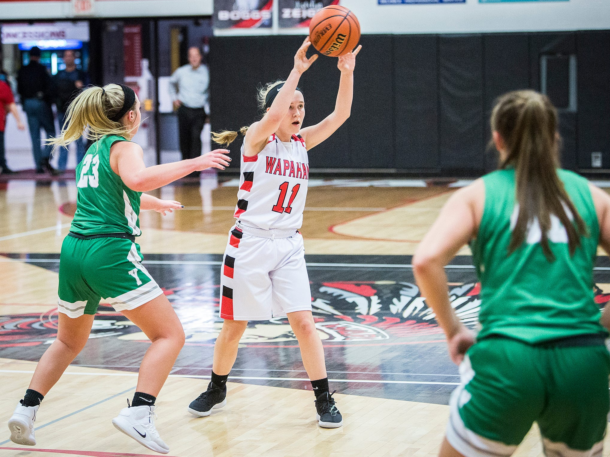 Wapahani's Madison Thompson passes the ball against Yorktown's defense during their game at Wapahani High School Tuesday, Dec. 4, 2018.