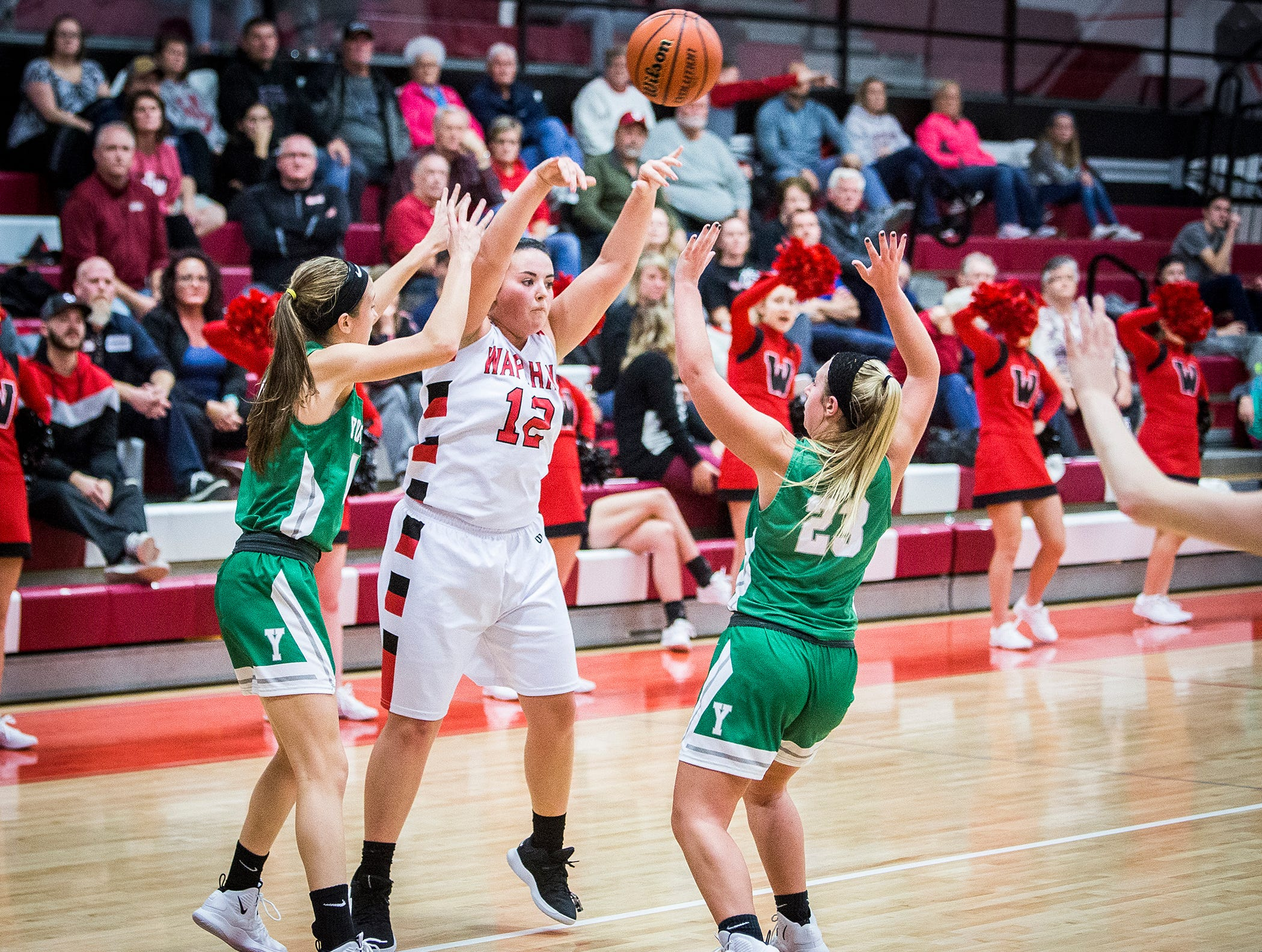 Wapahani's Dayten Lee passes over Yorktown's defense during their game at Wapahani High School Tuesday, Dec. 4, 2018.