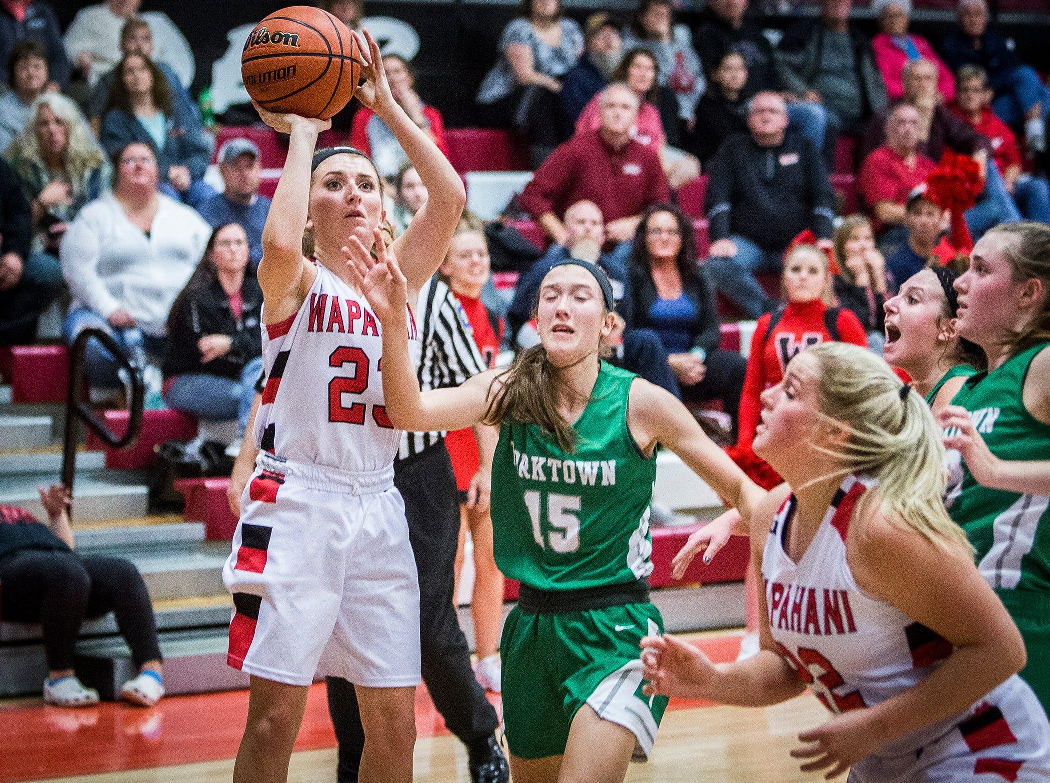 Wapahani's Carlie Boggs shoots against Yorktown's defense during their game at Wapahani High School Tuesday, Dec. 4, 2018.