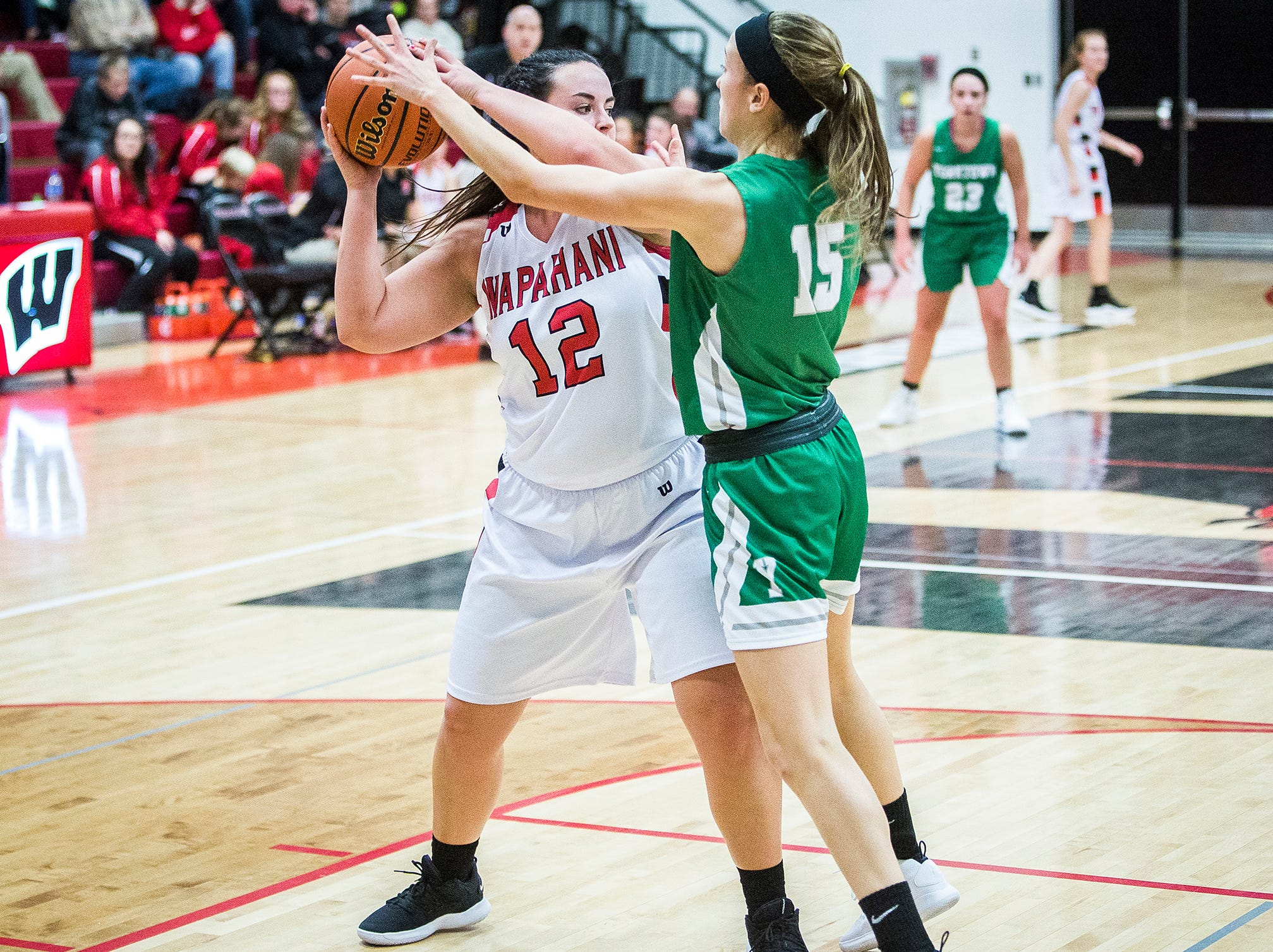 Wapahani's Dayten Lee looks to pass against Yorktown's defense during their game at Wapahani High School Tuesday, Dec. 4, 2018.