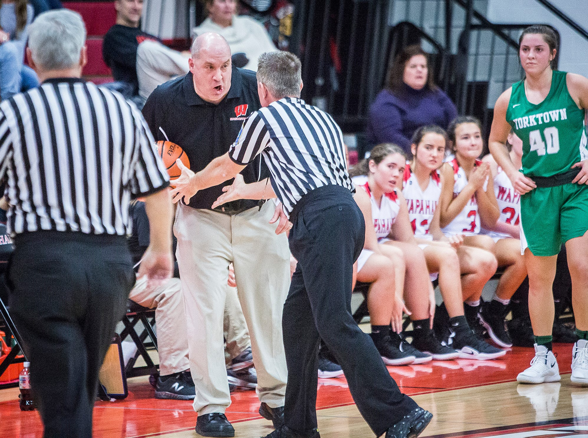 Wapahani coach Scott Hudson argues with an official during a game against Yorktown at Wapahani High School Tuesday, Dec. 4, 2018.