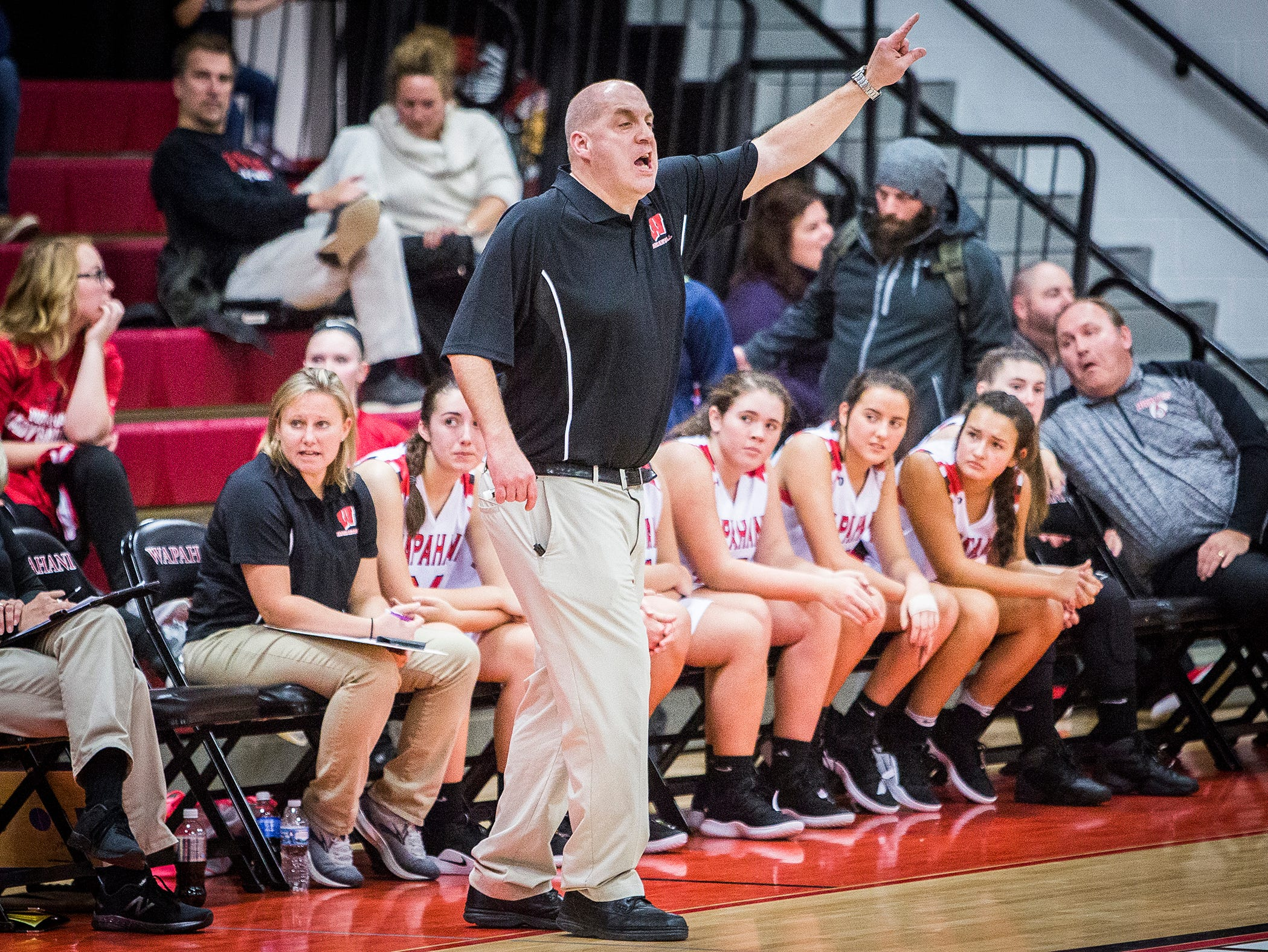 Wapahani coach Scott Hudson gives out instructions during a game against Yorktown at Wapahani High School Tuesday, Dec. 4, 2018.
