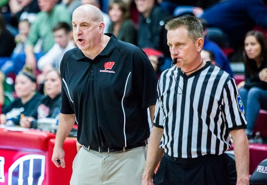 FILE -- Wapahani coach Scott Hudson gives out instructions during a game against Yorktown at Wapahani High School on Dec. 4, 2018.