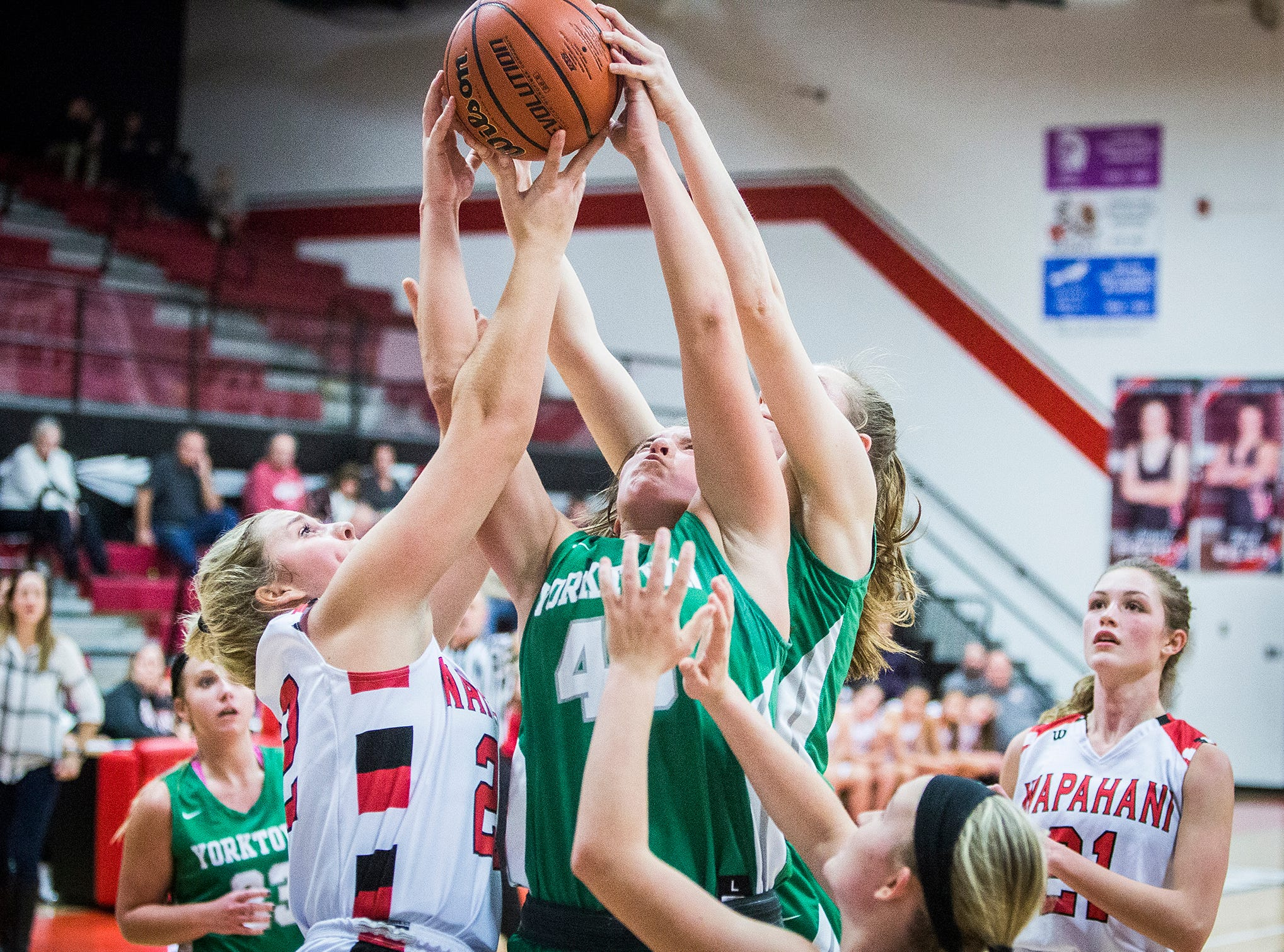 Yorktown's Ellie Miller grabs a rebound during their game against Wapahani at Wapahani High School Tuesday, Dec. 4, 2018.