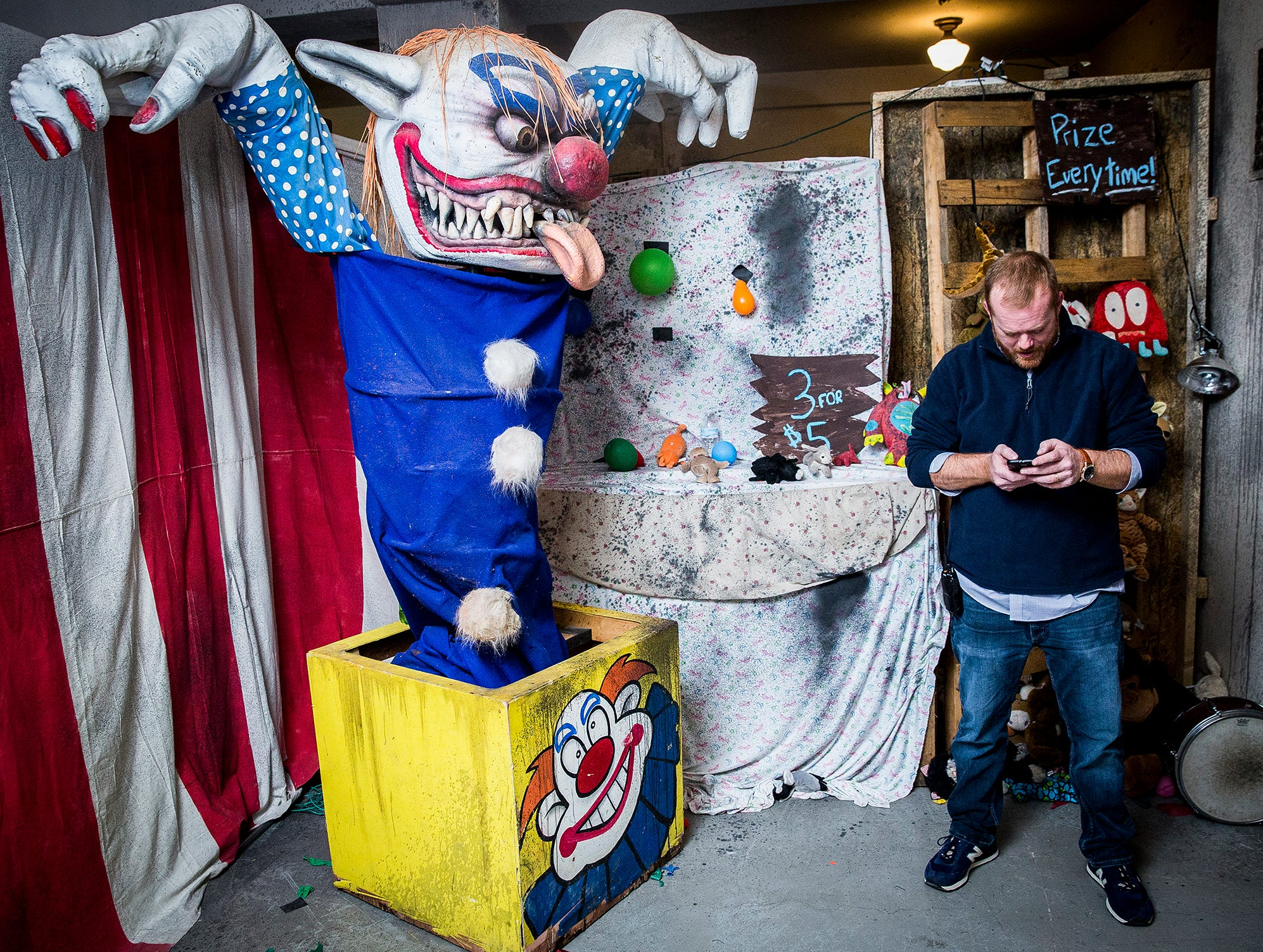 Jeff Robinson, associate executive director at Cornerstone, walks the future site of this year's Christmas Scarol, the annual Christmas-themed haunted house. The haunt opens Dec. 15.