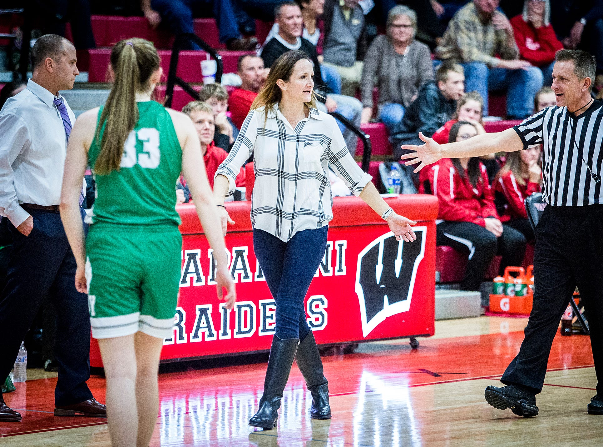 Yorktown coach Joy Matthews talks to the referee during a game at Wapahani High School Tuesday, Dec. 4, 2018.