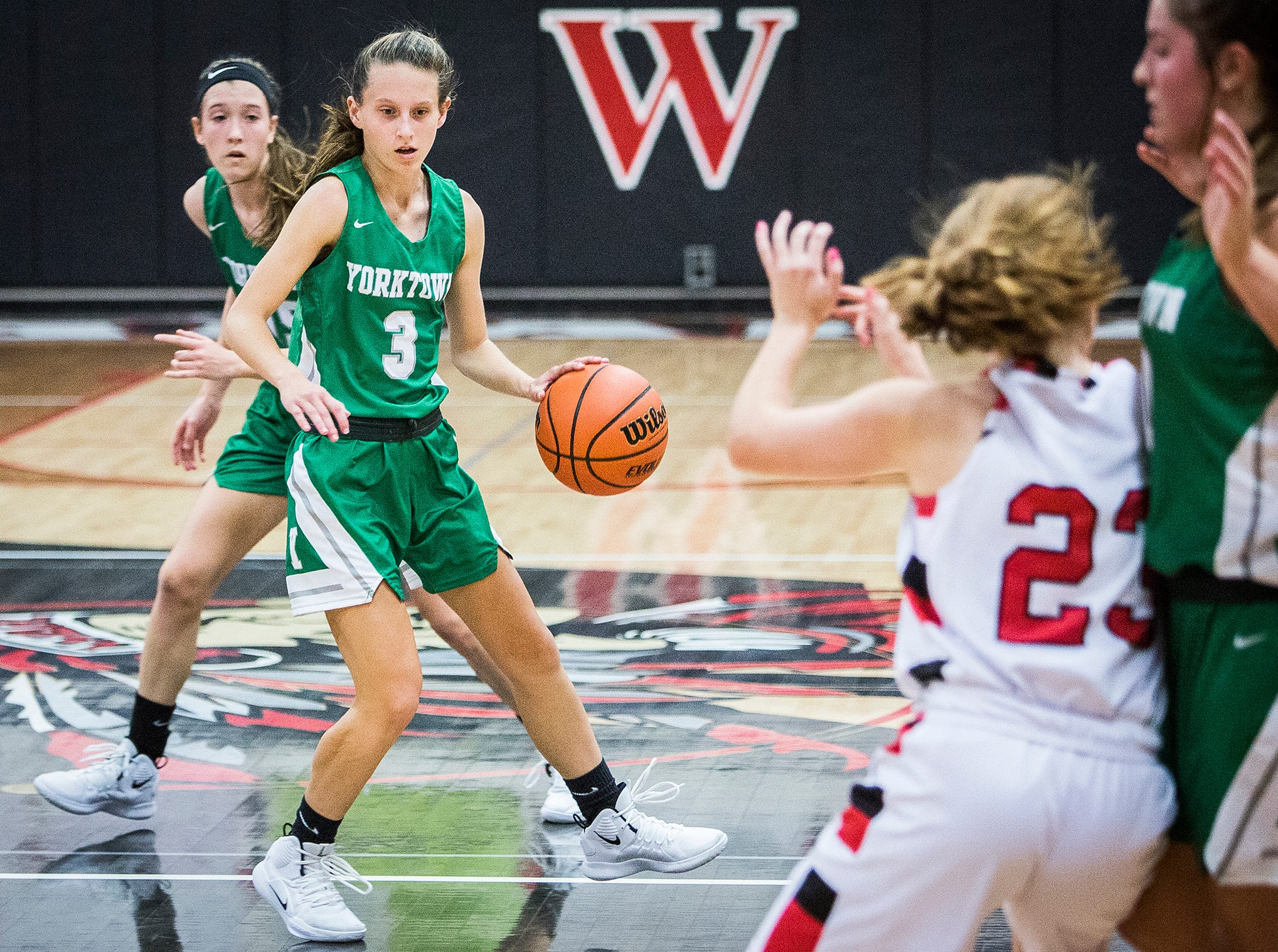 Yorktown's Elizabeth Reece dribbles against Wapahani's defense during their game at Wapahani High School Tuesday, Dec. 4, 2018.