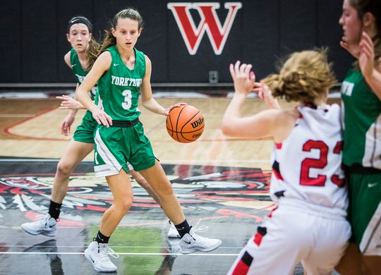FILE -- Yorktown's Elizabeth Reece dribbles past Wapahani's defense during their game at Wapahani High School Tuesday, Dec. 4, 2018.