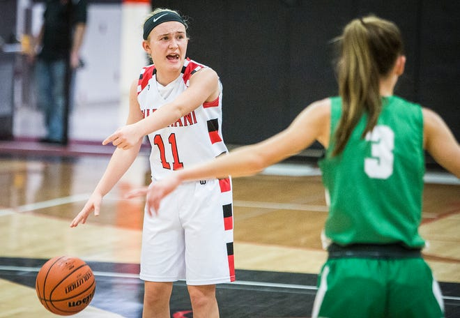 FILE -- Wapahani's Madison Thompson moves the ball against Yorktown's defense during their game at Wapahani High School on Dec. 4, 2018.