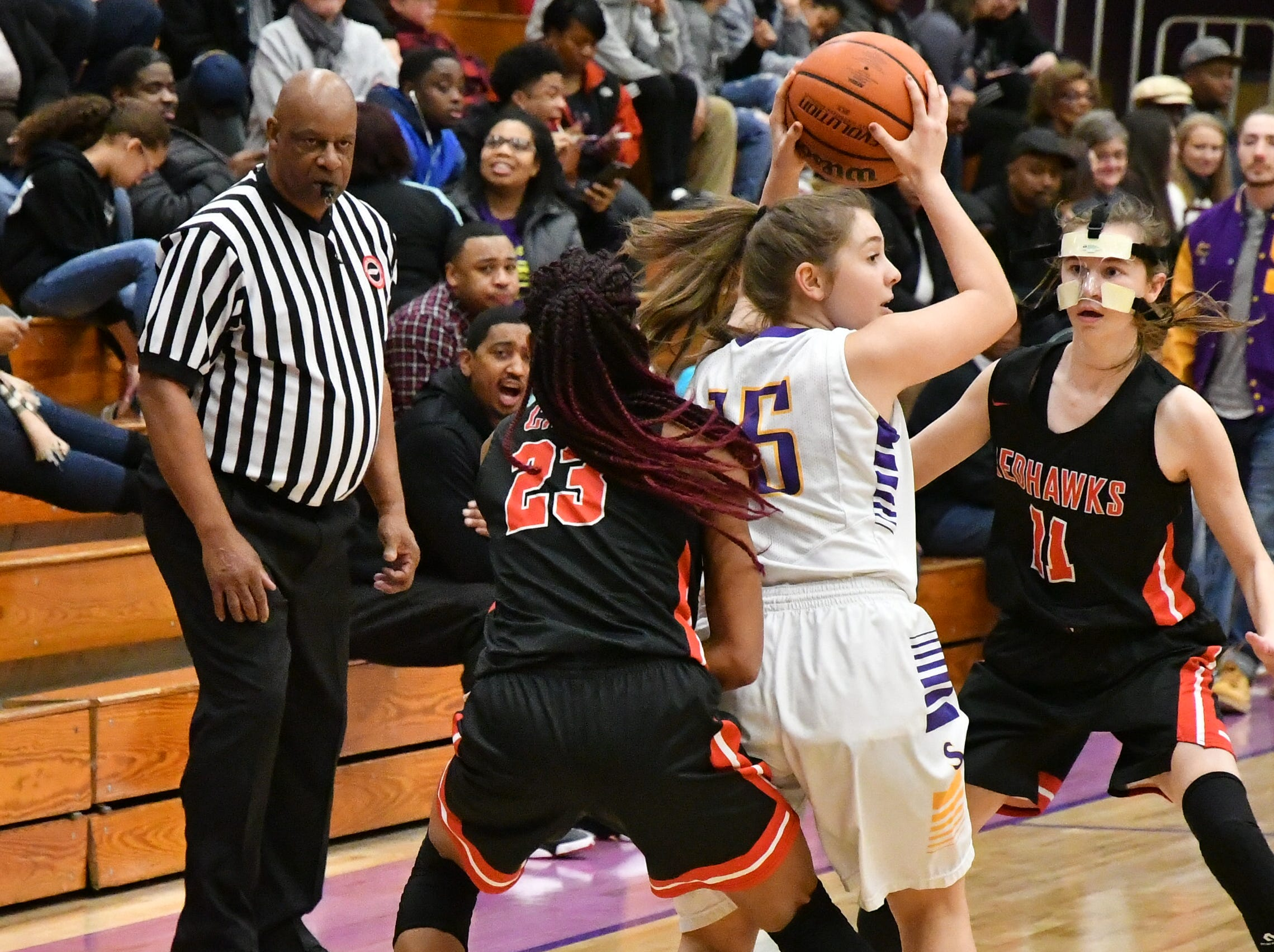 Smyrna's Georgia Charlton is trapped by Stewarts Creek's Zhordan Shannon (23) and Madison Hatcher Tuesday.