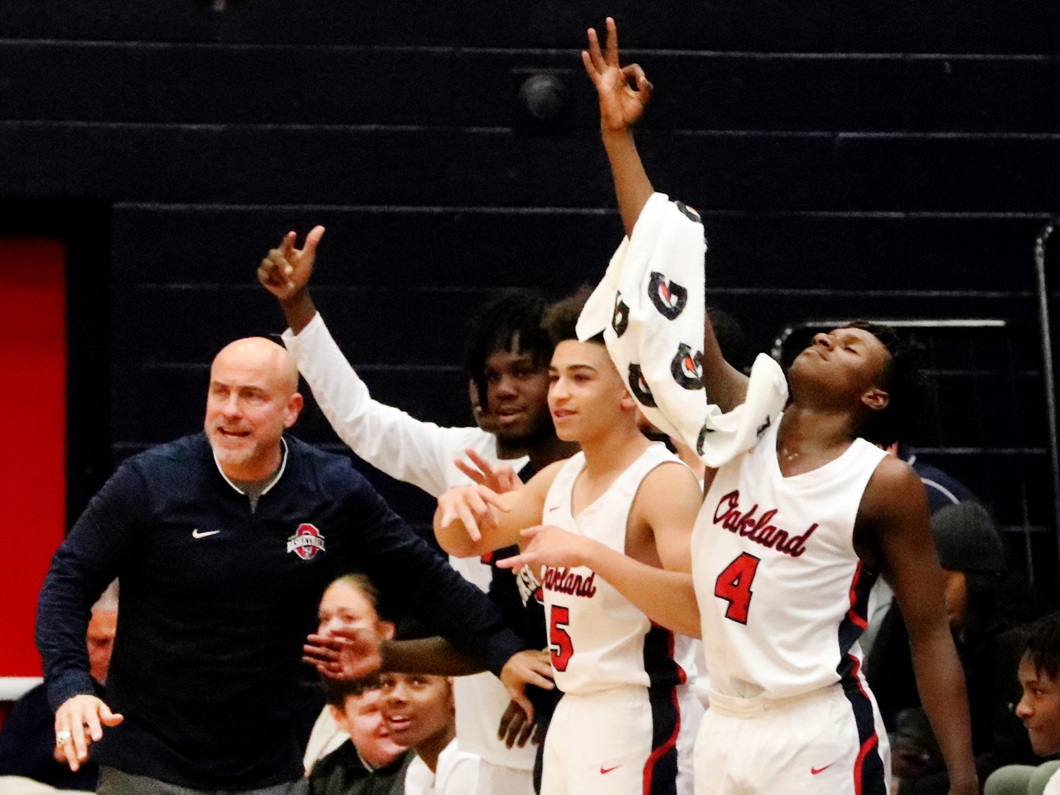 Oakland's head coach Troy Bond tries to calm the bench as they celebrate a player making a three point shot against Siegel on Tuesday, Dec.. 4, 2018.
