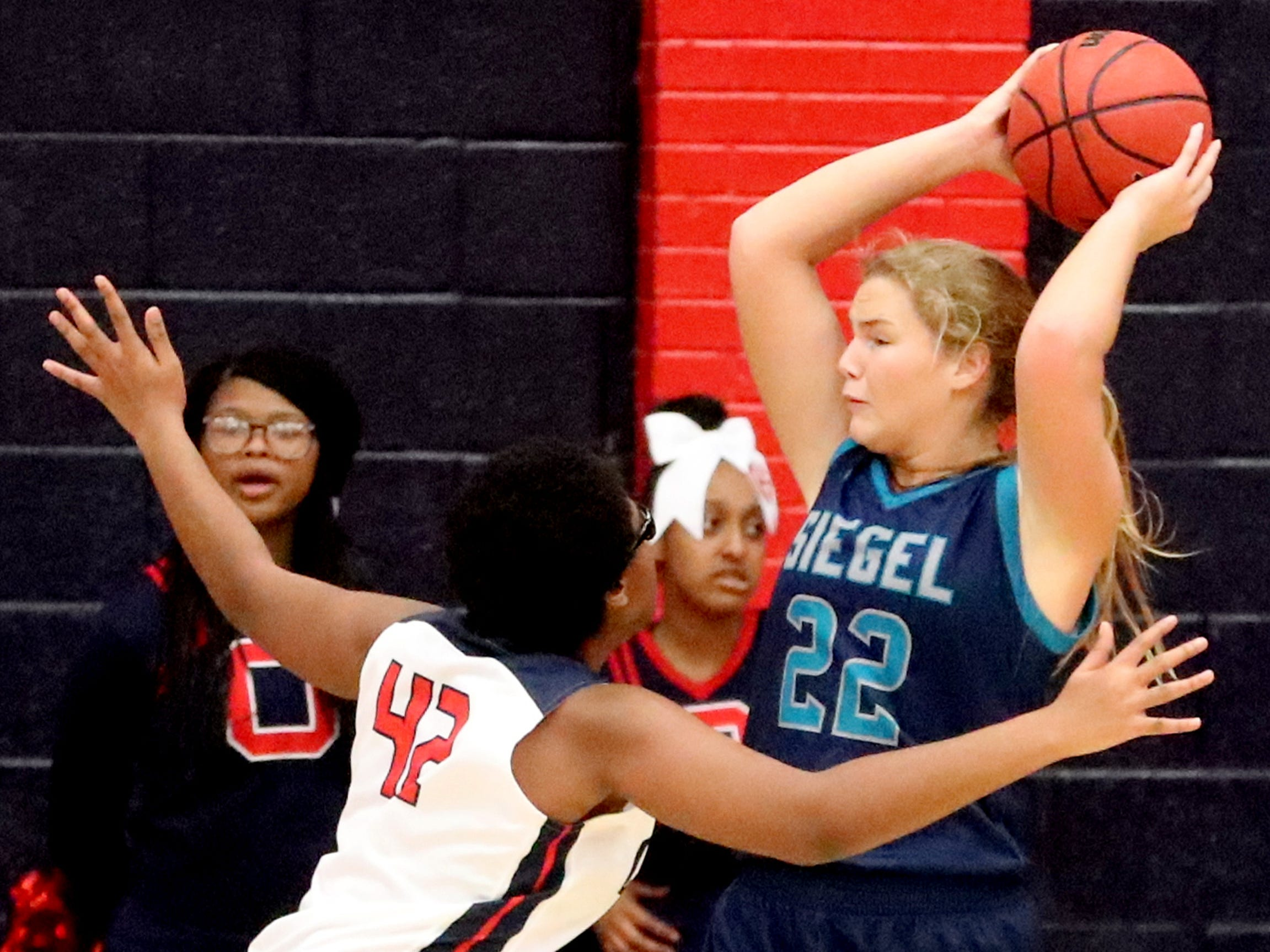 Siegel's Taylor Patterson (22) looks for a player to pass to as Oakland's Nicole Egeruoh (42) guards her during the game at Oakland on Tuesday, Dec.. 4, 2018.