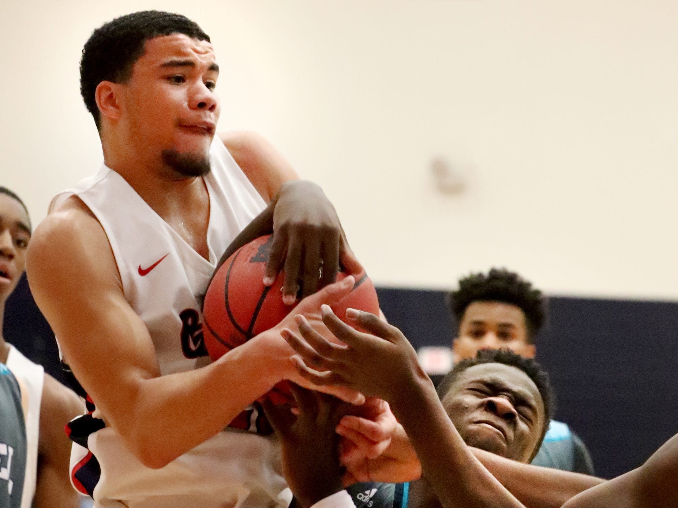 Oakland's Lamarius Jackson (25) and Siegel's Ethan Jones (3) fights for position of the ball during the game at Oakland on Tuesday, Dec.. 4, 2018.