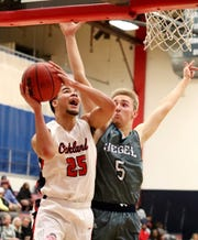 Oakland's Lamarius Jackson (25) goes up for a basket as Siegel's Tyler Erdman (5) guards him during the game at Oakland on Tuesday, Dec.. 4, 2018.