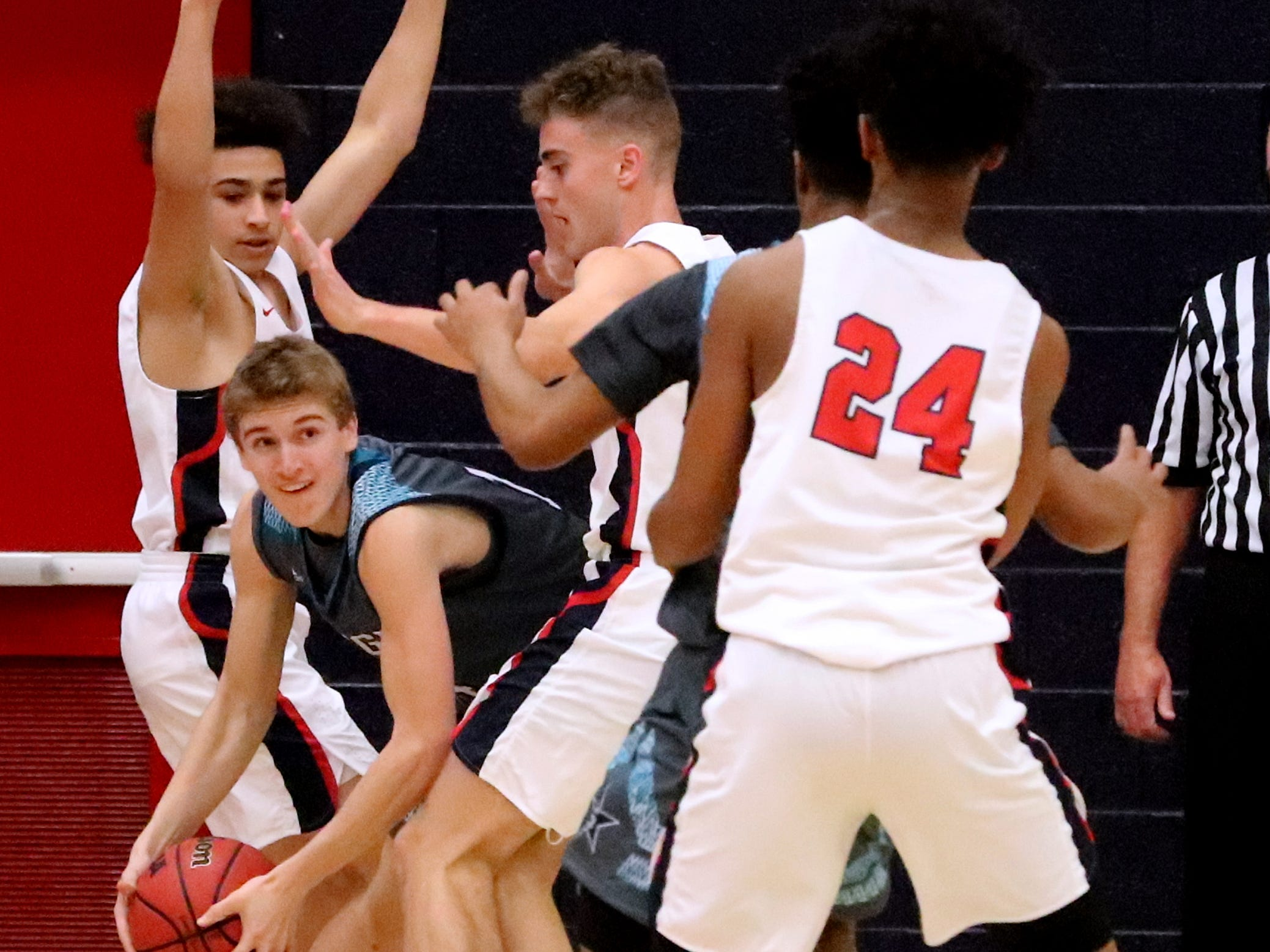 Siegel's Matthew Schneider (14) is trapped between Oakland's Reggie Cooper (5) and Carter Baugh (32) during the game at Oakland on Tuesday, Dec.. 4, 2018.