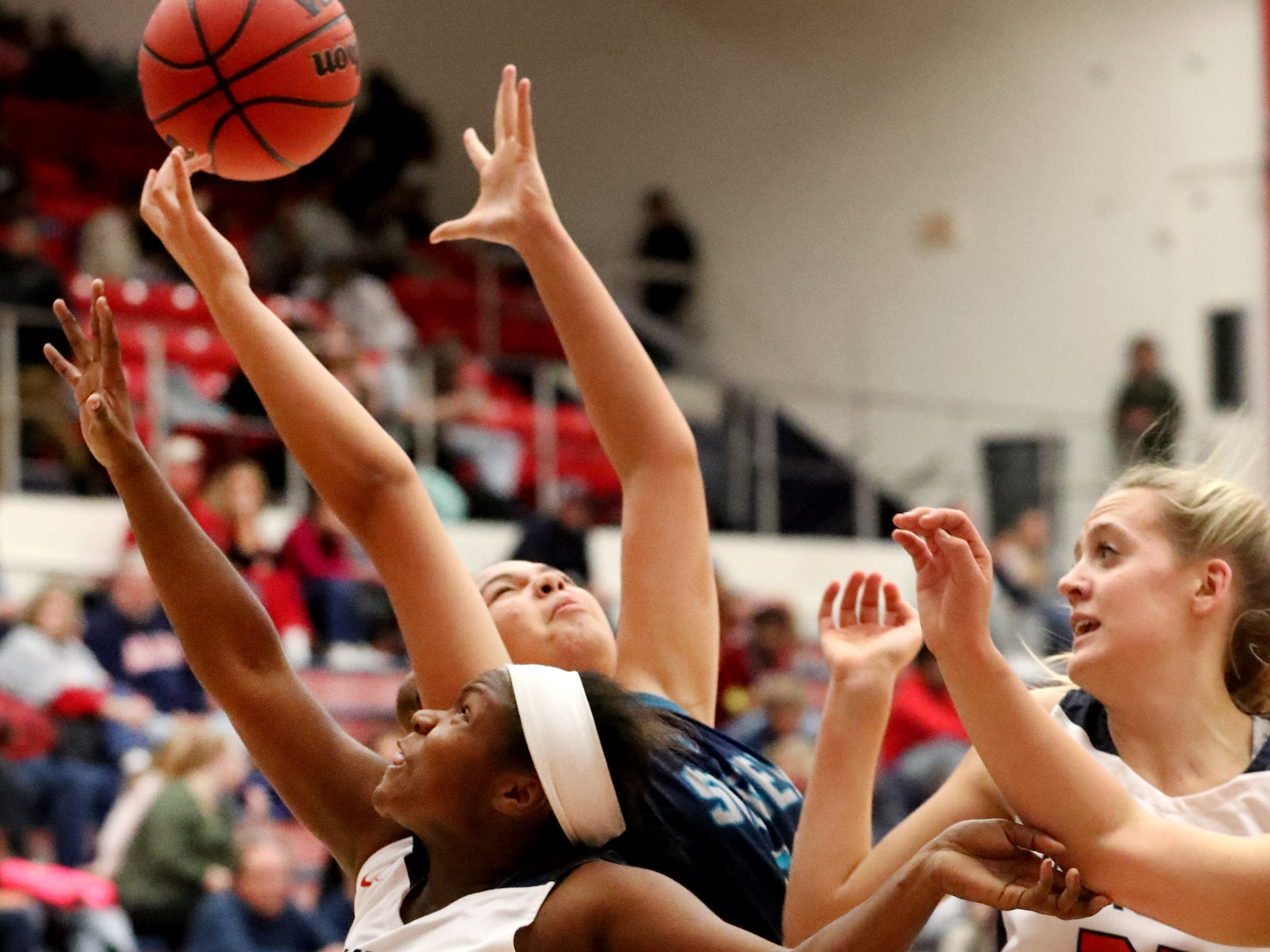 Oakland's Erykah Collier (32), Siegel's Genesis Sneed (40) and Oakland's Jane Cluff (21) all go for a rebound during the game at Oakland on Tuesday, Dec.. 4, 2018.