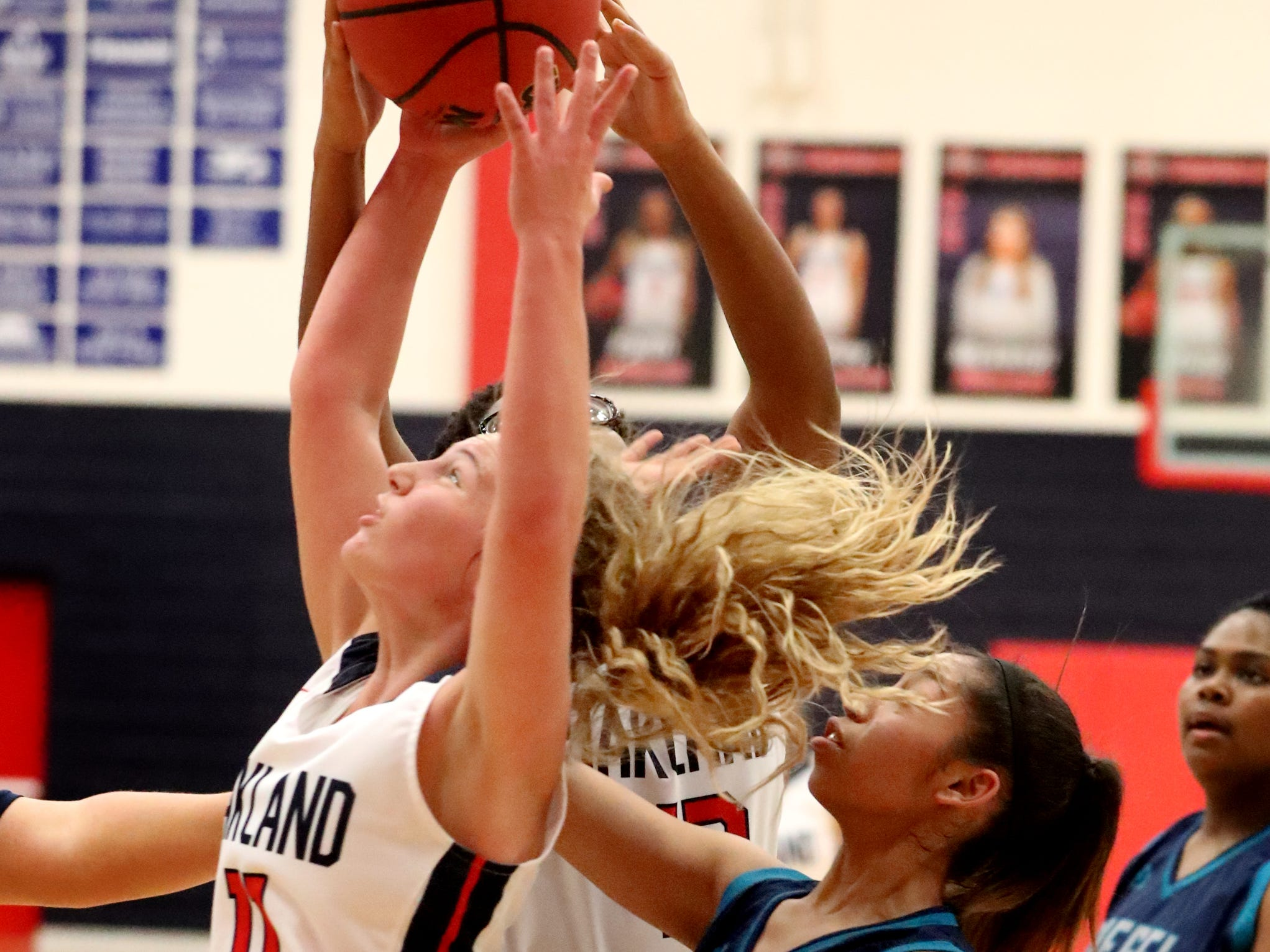 Oakland's Claira McGowan (11) goes after a rebound during the game against Siegel at Oakland on Tuesday, Dec.. 4, 2018.