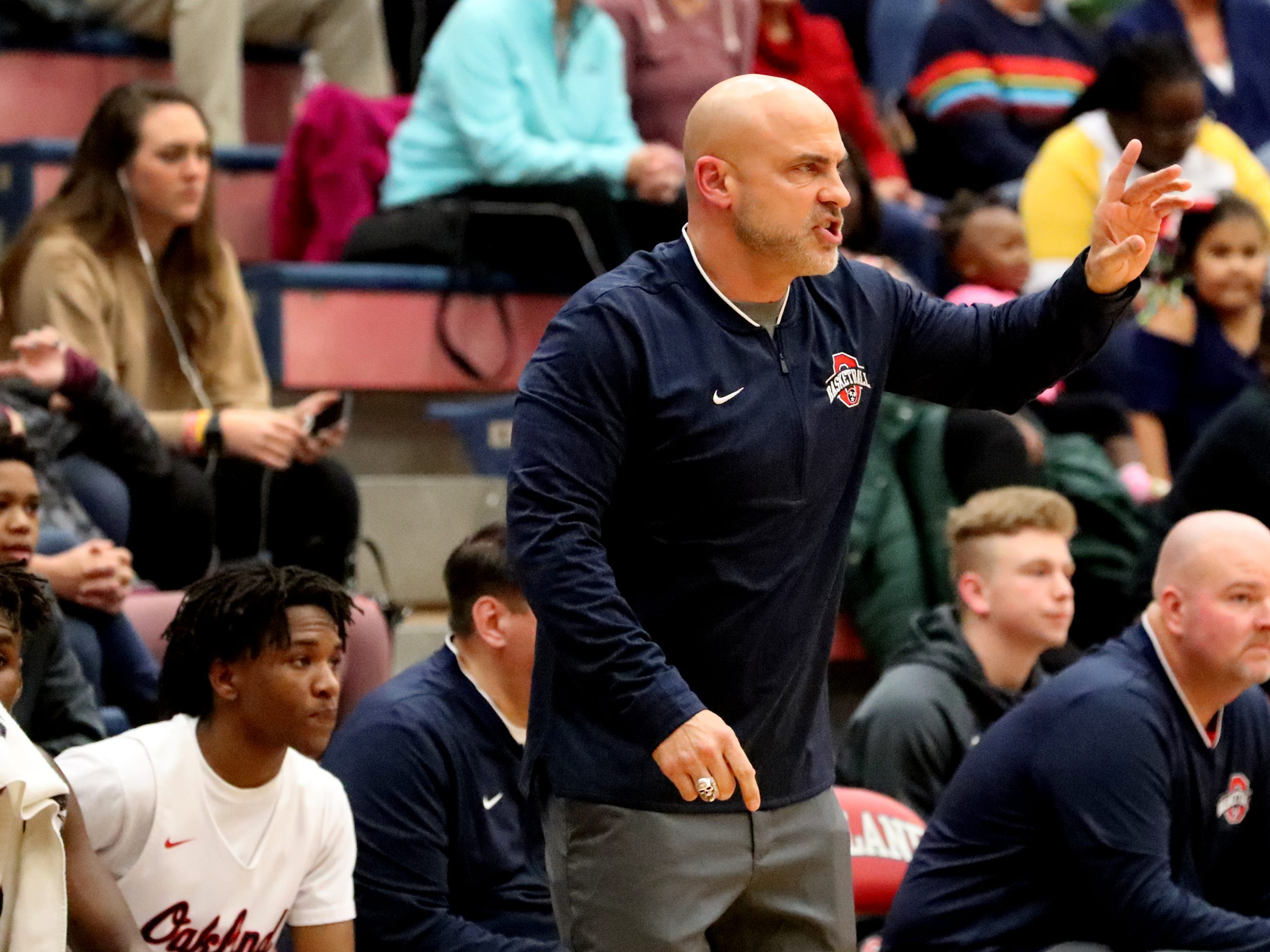 Oakland's boys head coach Troy Bond on the sidelines during the game against Siegel on Tuesday, Dec.. 4, 2018.