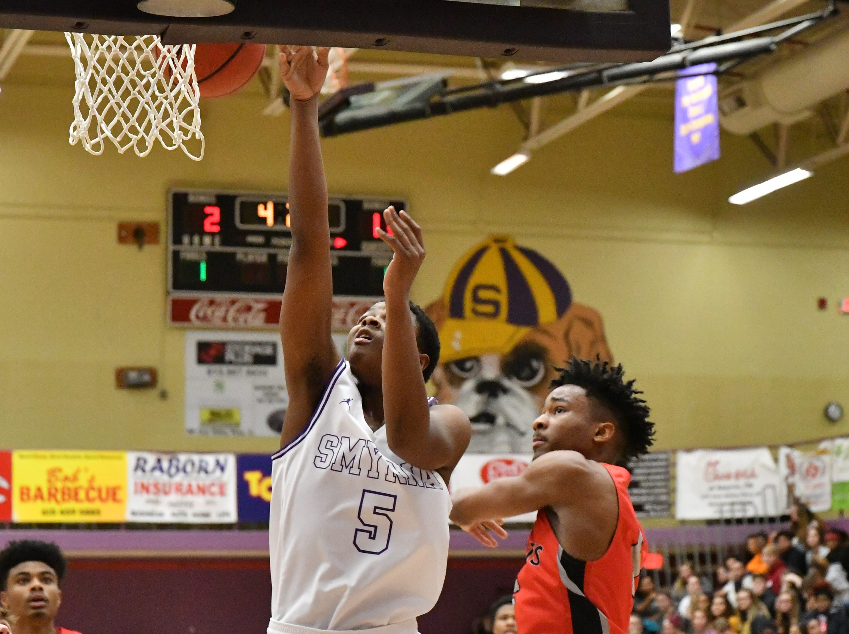 Smyrna's Emmanuel Dixon goes up for a layup during Tuesday's loss to Stewarts Creek.