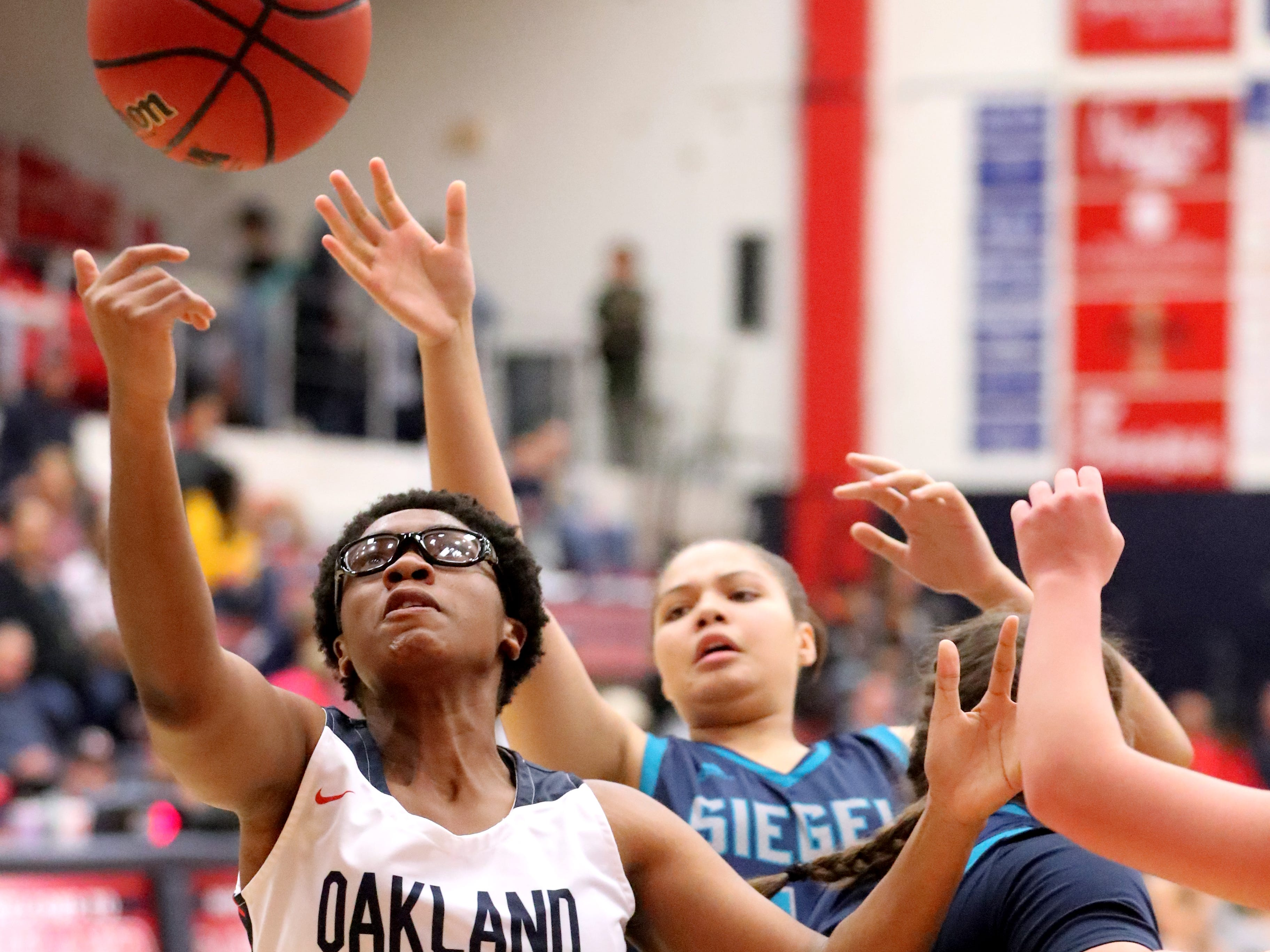 Oakland's Nicole Egeruoh (42) goes after a rebound during the game against Siegel at Oakland on Tuesday, Dec.. 4, 2018.