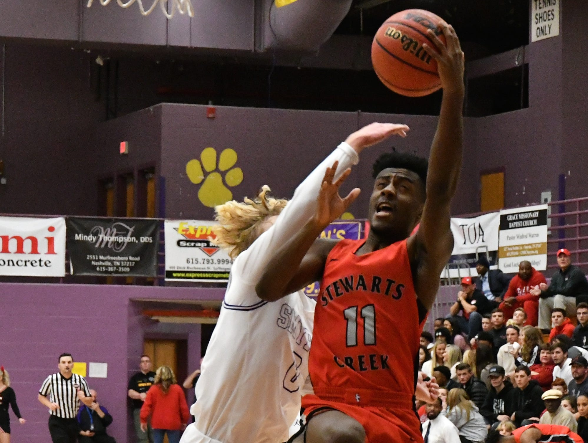 Stewarts Creek's Donovan Jackson goes in for a layup during Tuesday's win at Smyrna.