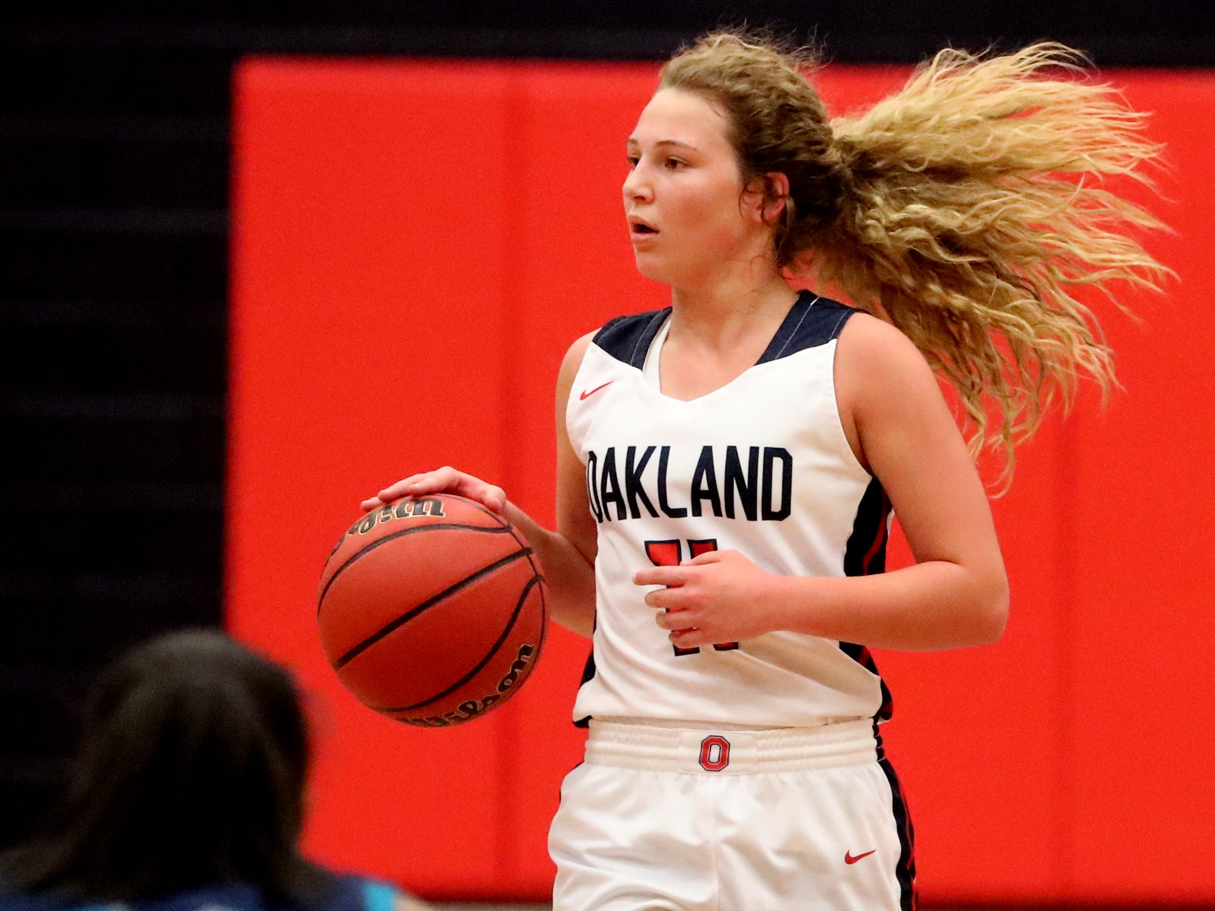Oakland's Claira McGowan (11) brings the ball down the court during the game against Siegel at Oakland on Tuesday, Dec. 4, 2018.