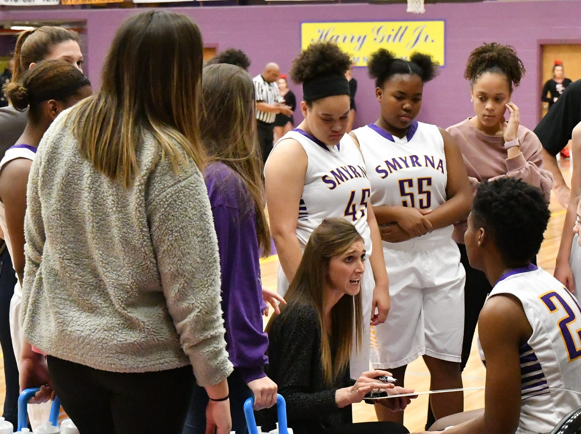 Smyrna coach Jordyn Hartsfield talks to her squad during Tuesday's game against Stewarts Creek.