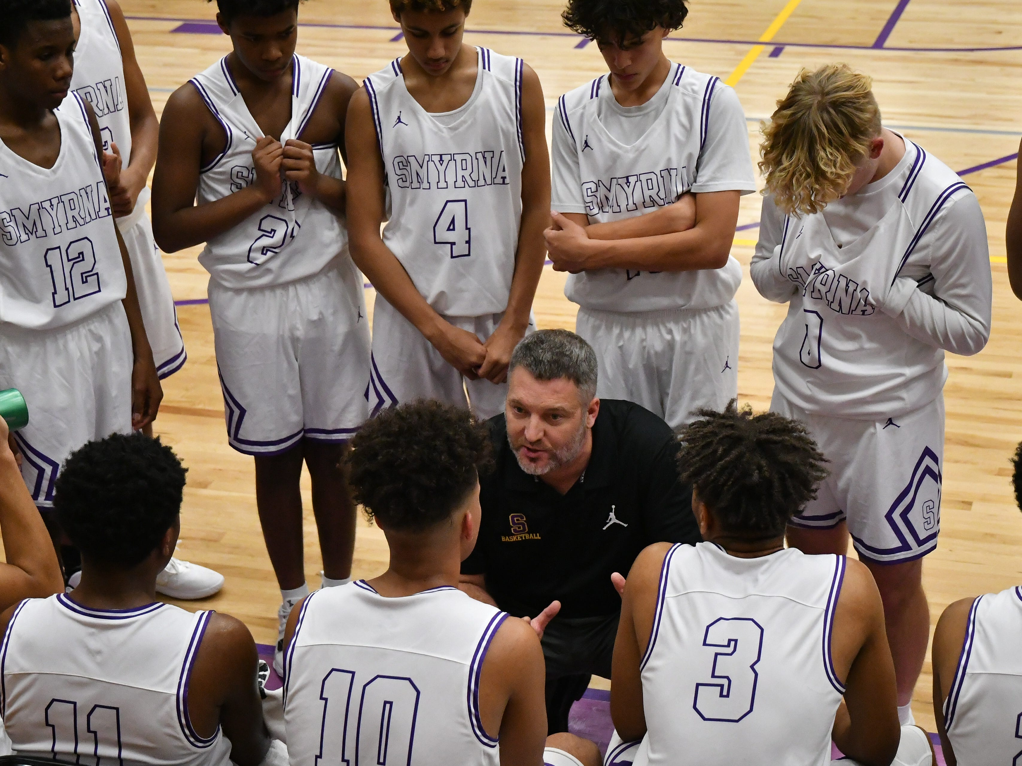 Smyrna coach Mike Wright talks to his squad during Tuesday's game against Stewarts Creek.