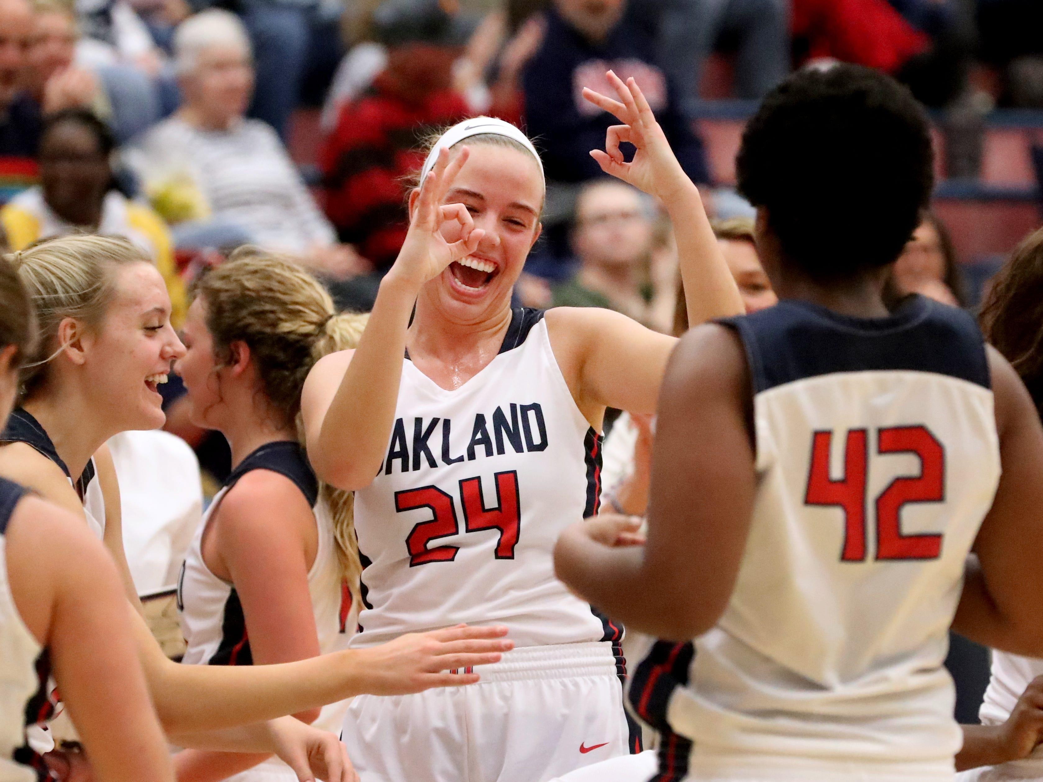 Oakland's Olivia Perry (24) celebrates a 3 point shot at the 3rd quarter buzzer made by Oakland's Erykah Collier (32) during the game against the Siegel at Oakland on Tuesday, Dec.. 4, 2018.