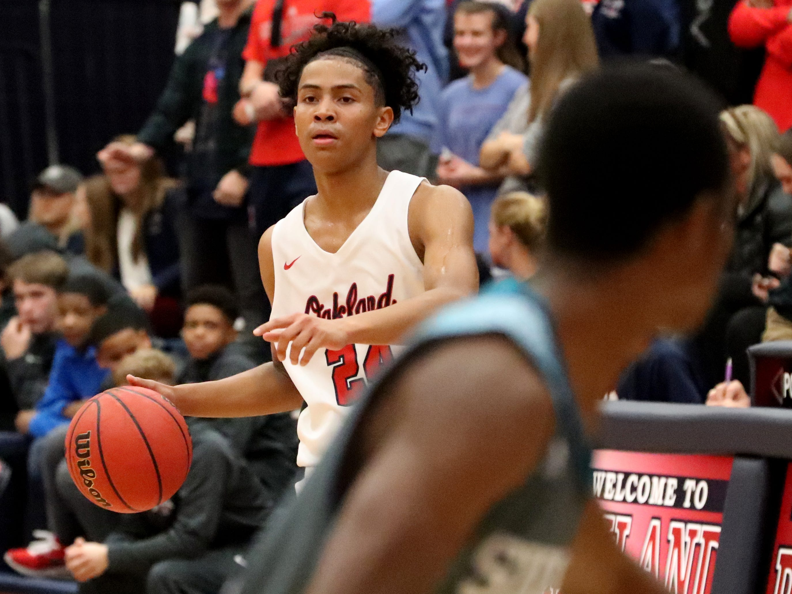 Oakland's Jaden Jamison (24) brings the ball down the court during the game against Oakland at Oakland on Tuesday, Dec.. 4, 2018.