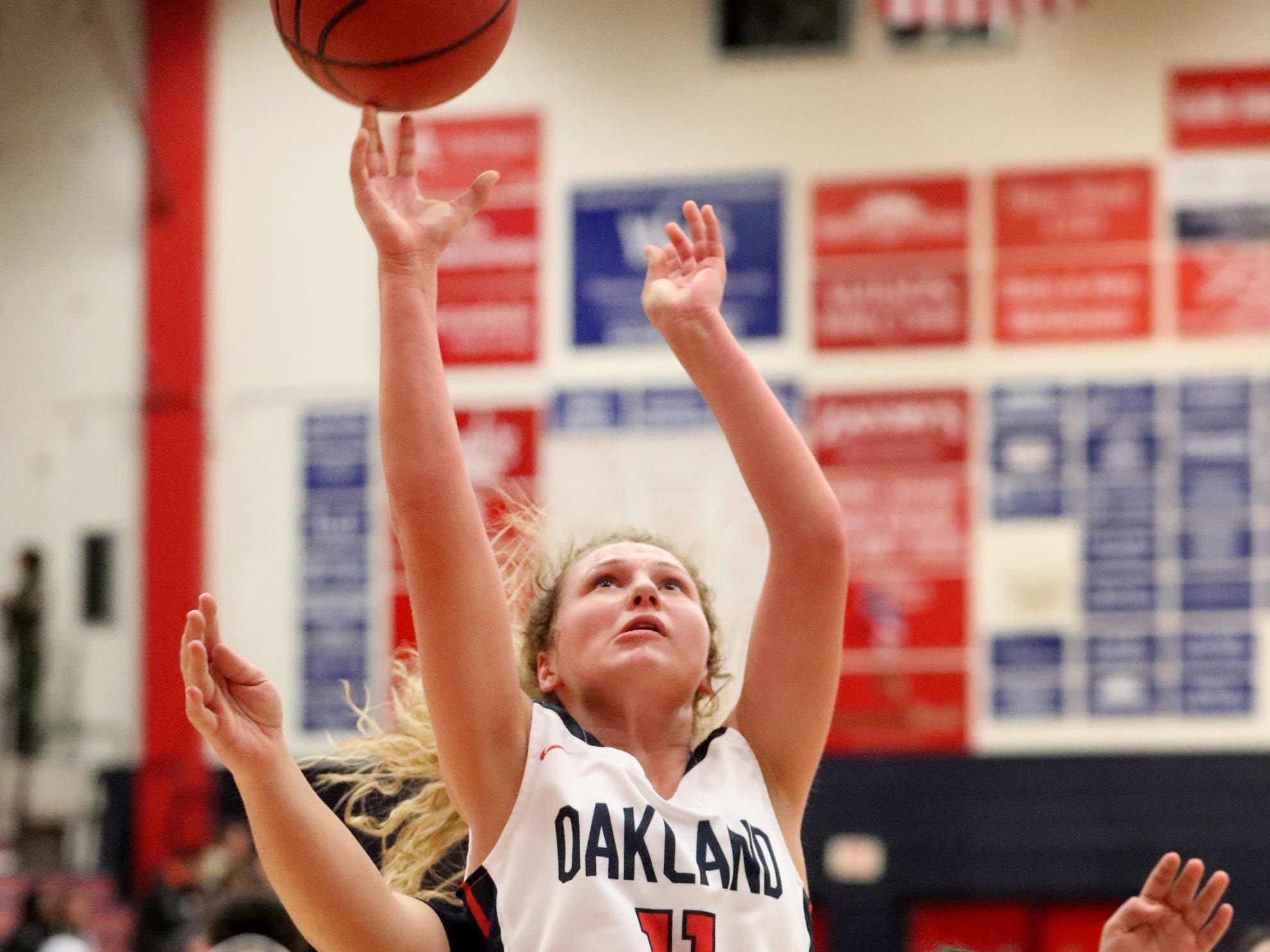 Oakland's Claira McGowan (11) shoots the ball during the game against Siegel at Oakland on Tuesday, Dec.. 4, 2018.