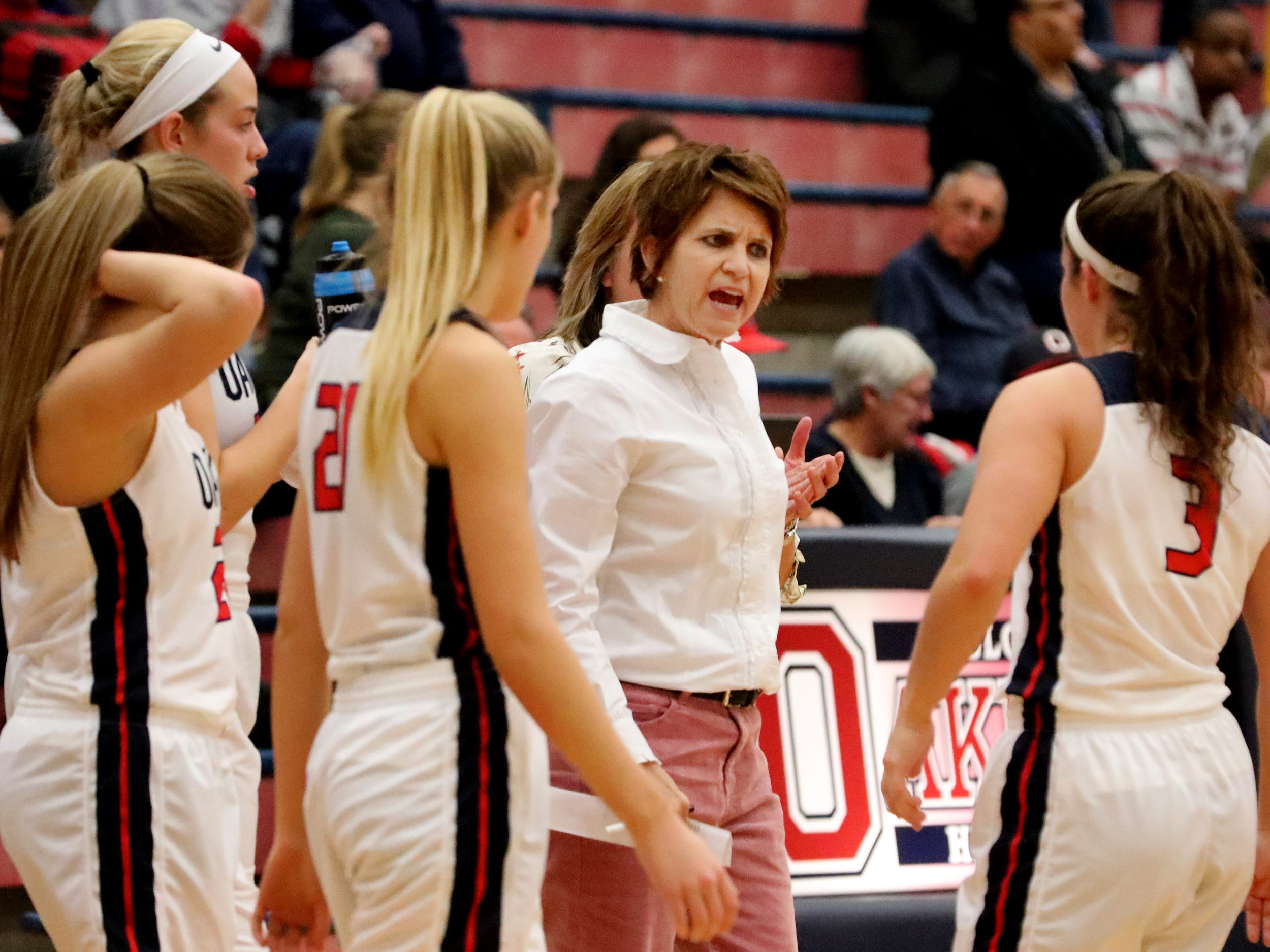 Oakland girls head coach Jennifer Grandstaff talks with her team during a time out  in the game against Siegel at Oakland on Tuesday, Dec.. 4, 2018.