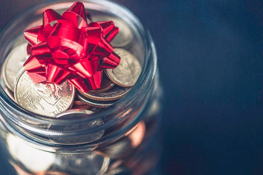 Christmas Money Jar With American Currency And Topped With Bow