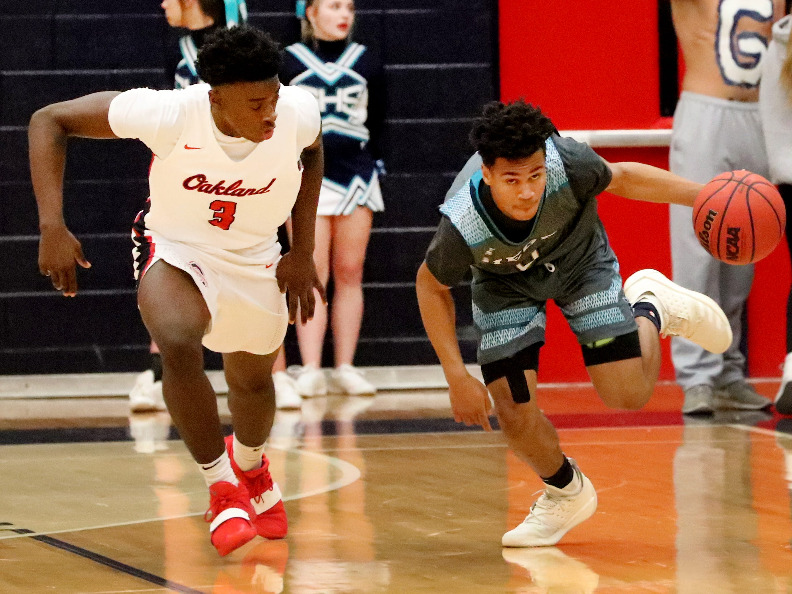 Siegel's Zion Swader (0) takes the ball up the court as Oakland's DeArre McDonald (3) follows him during the game at Oakland on Tuesday, Dec.. 4, 2018.