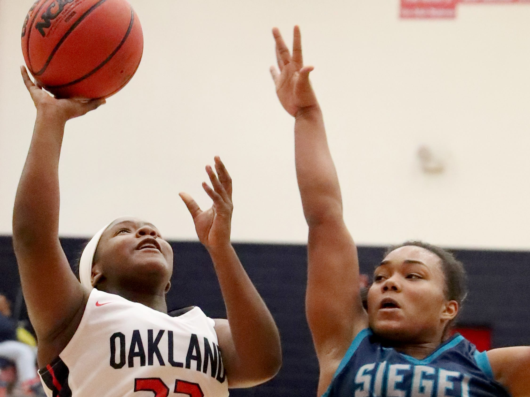 Oakland's Erykah Collier (32) shoots the ball as Siegel's Serenity Lillard (23) guards her during the game at Oakland on Tuesday, Dec.. 4, 2018.