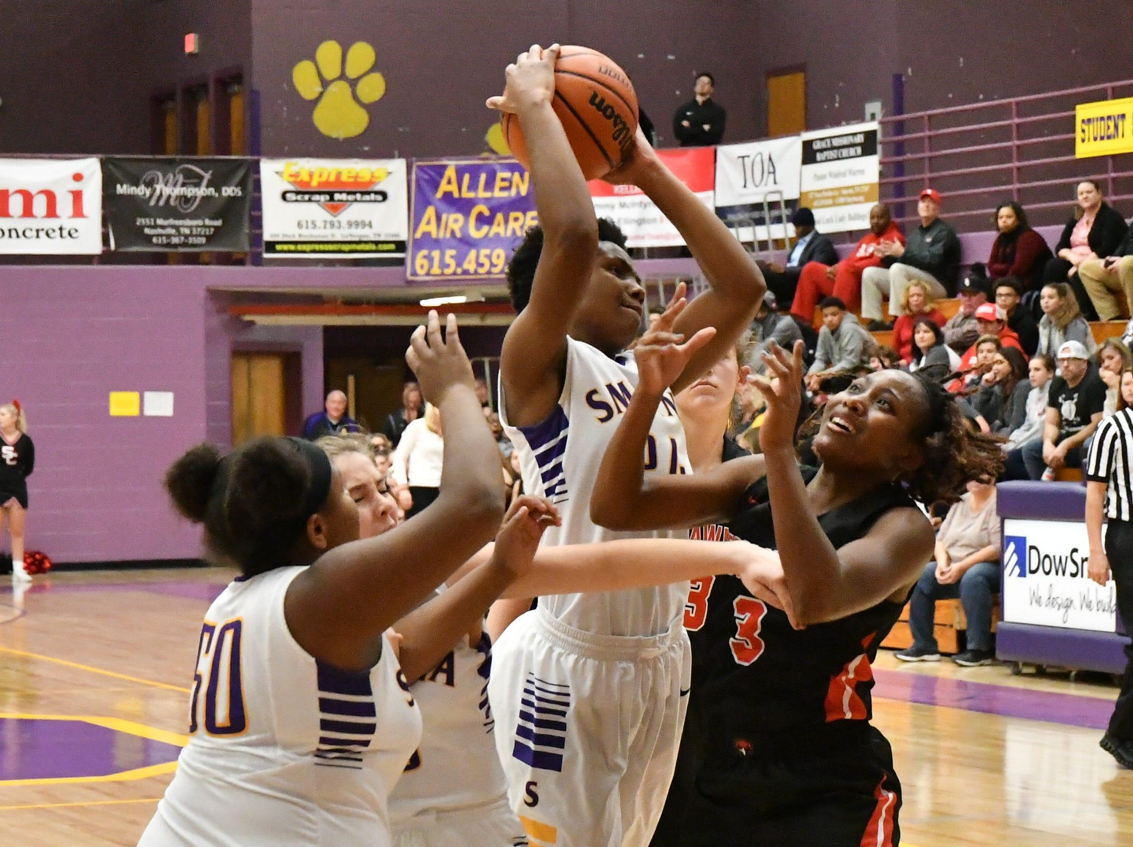 Smyrna's Nakia Drew battles inside as Stewarts Creek players defend.