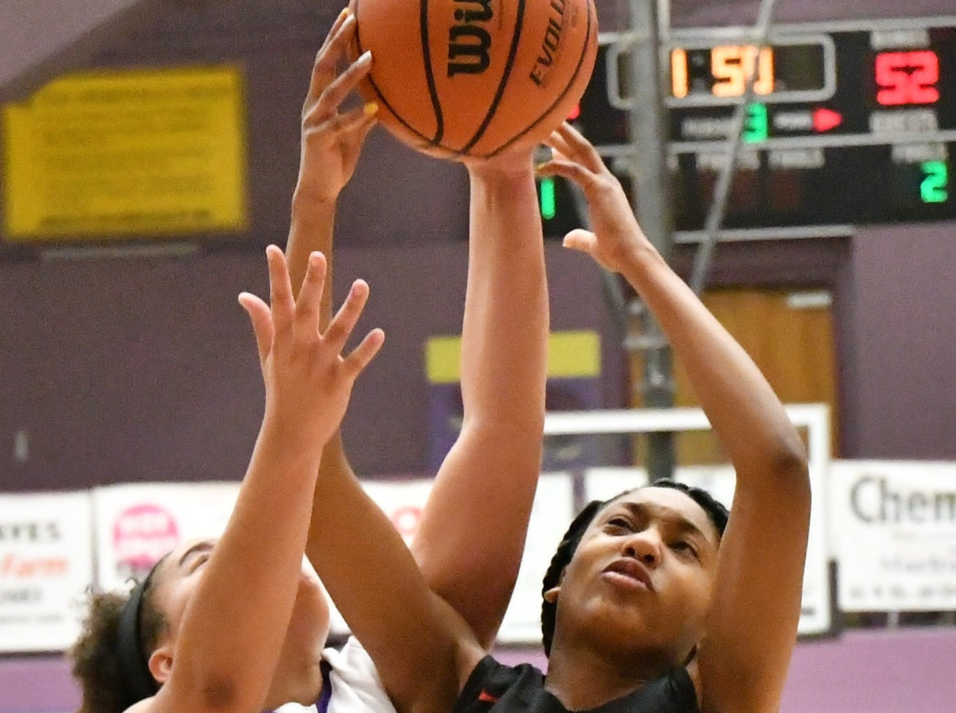 Smyrna's Chloe Wilder gets a hand on a shot attempt by Stewarts Creek's Zyion Shannon Tuesday.