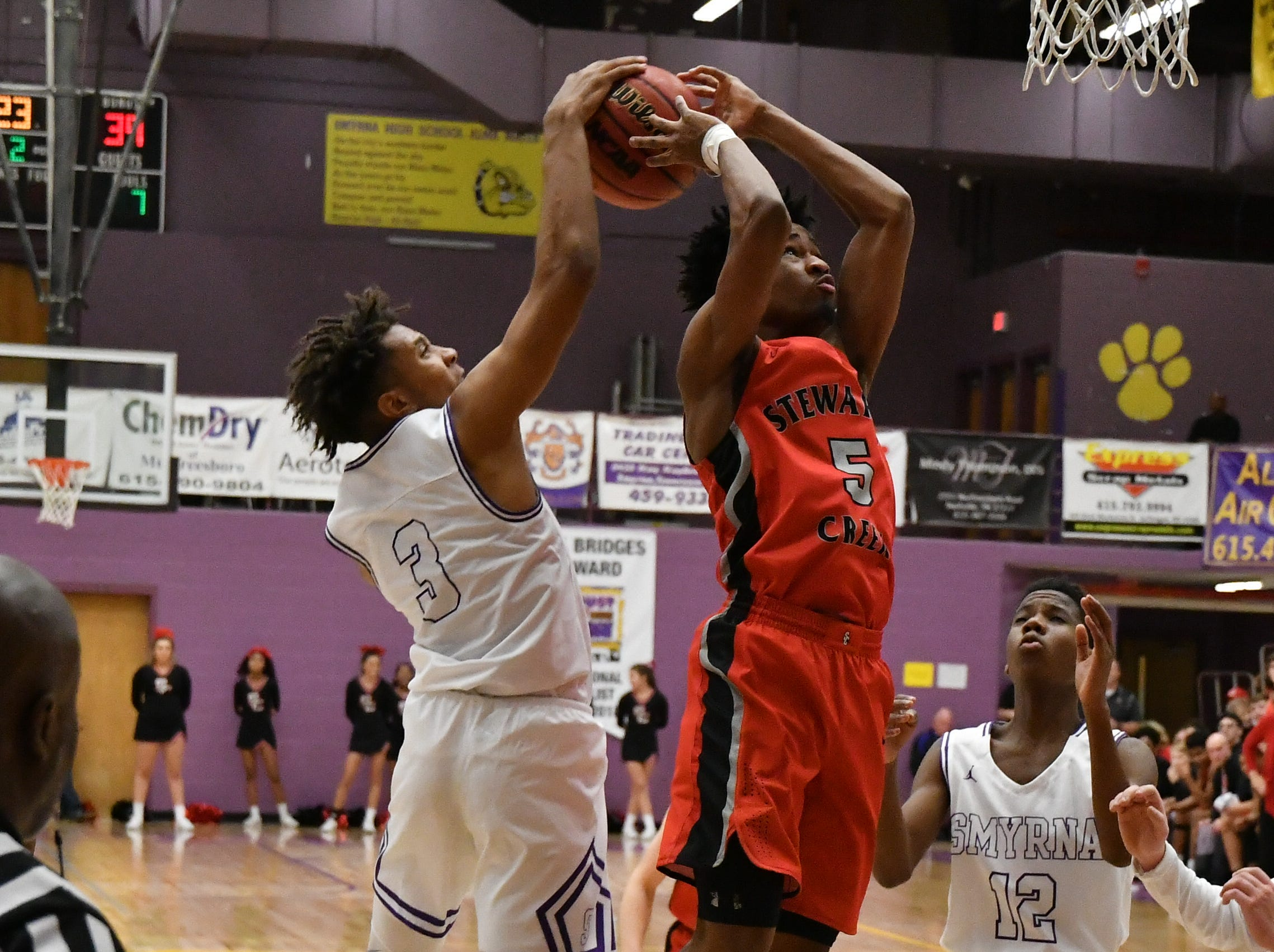Smyrna's Thomas Riddle gets a hand on the shot attempt by Stewarts Creek's Memphis Horner.