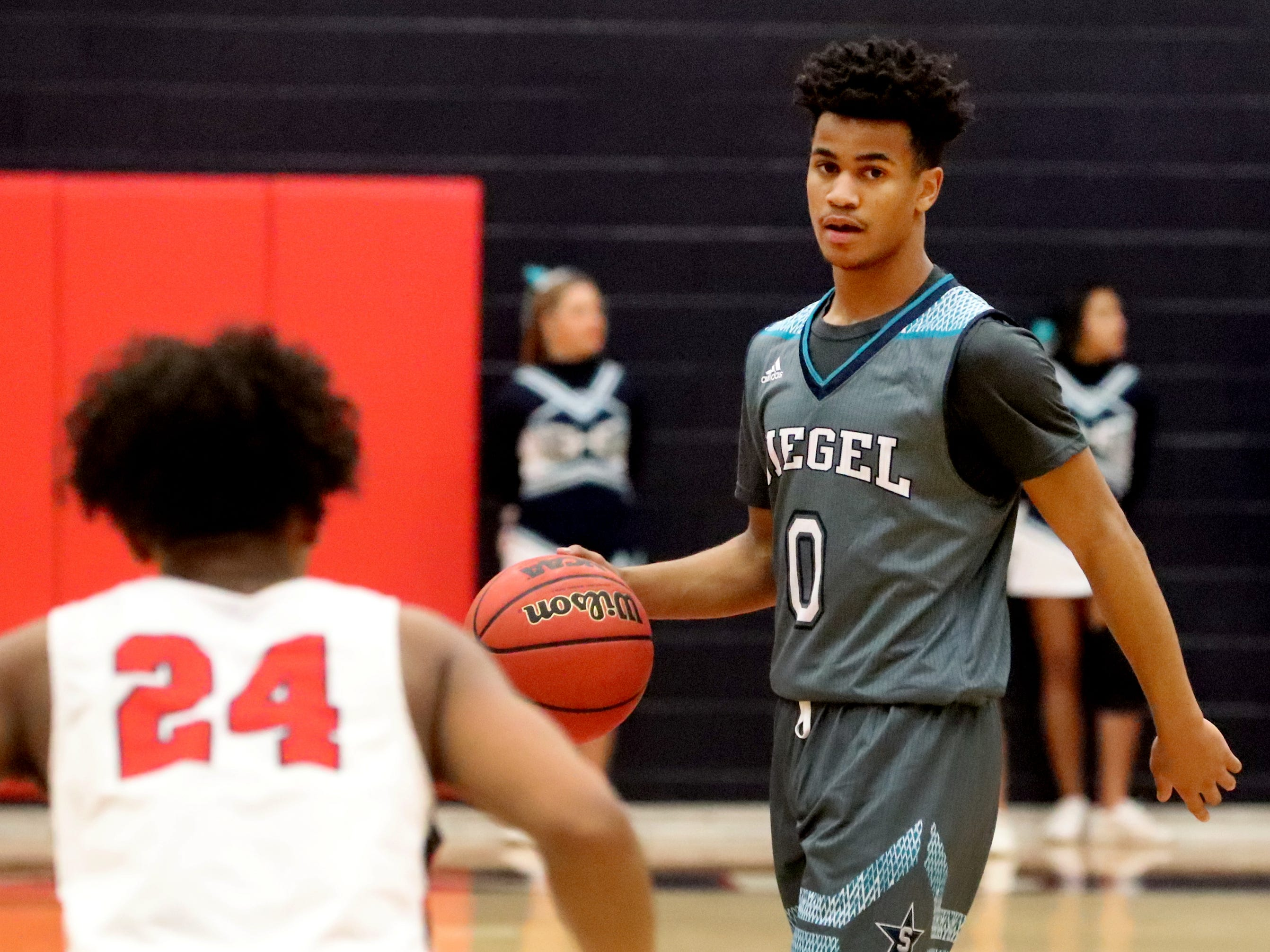 Siegel's Zion Swader (0) brings the ball down the court as he looks for a way to the basket during the game against Oakland on Tuesday, Dec.. 4, 2018.