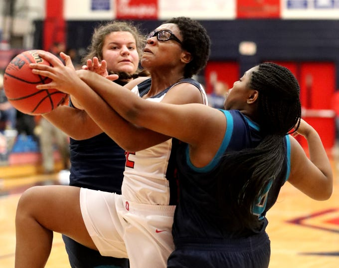 Oakland's Nicole Egeruoh (42) grabs a rebound as Siegel's Erin Vanhook (42) and Genesis Sneed (40) also fight for the rebound on Tuesday, Dec. 4, 2018.