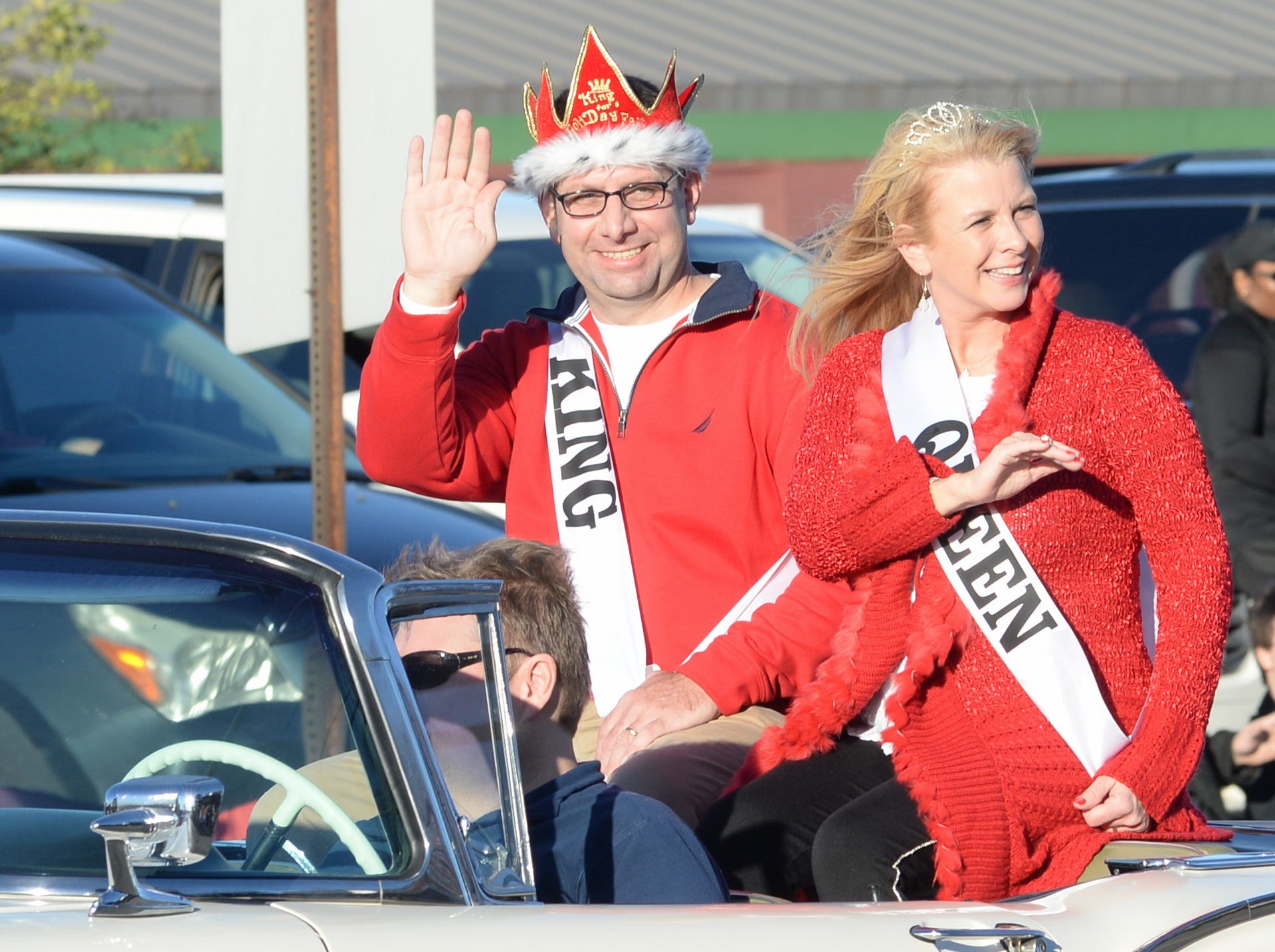 2018 HolidayFest King and Queen Tommy and Rachel McAuley participate in the Hendersonville Christmas Parade on Sunday, Dec. 2.