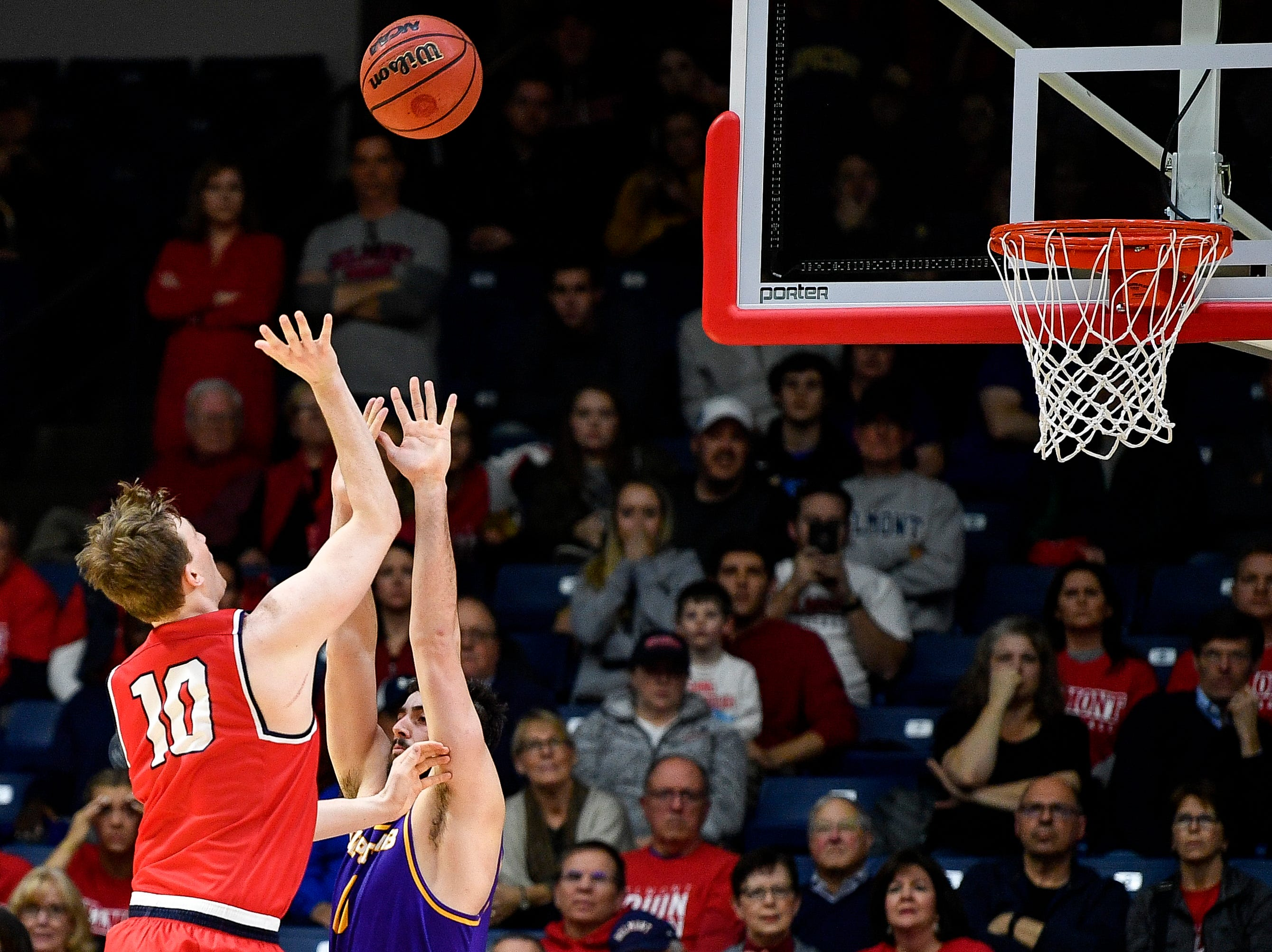 Belmont forward Caleb Hollander (10) scores the game-winning basket past Lipscomb forward Rob Marberry (0) during the second half at the Curb Event Center in Nashville, Tenn., Tuesday, Dec. 4, 2018.