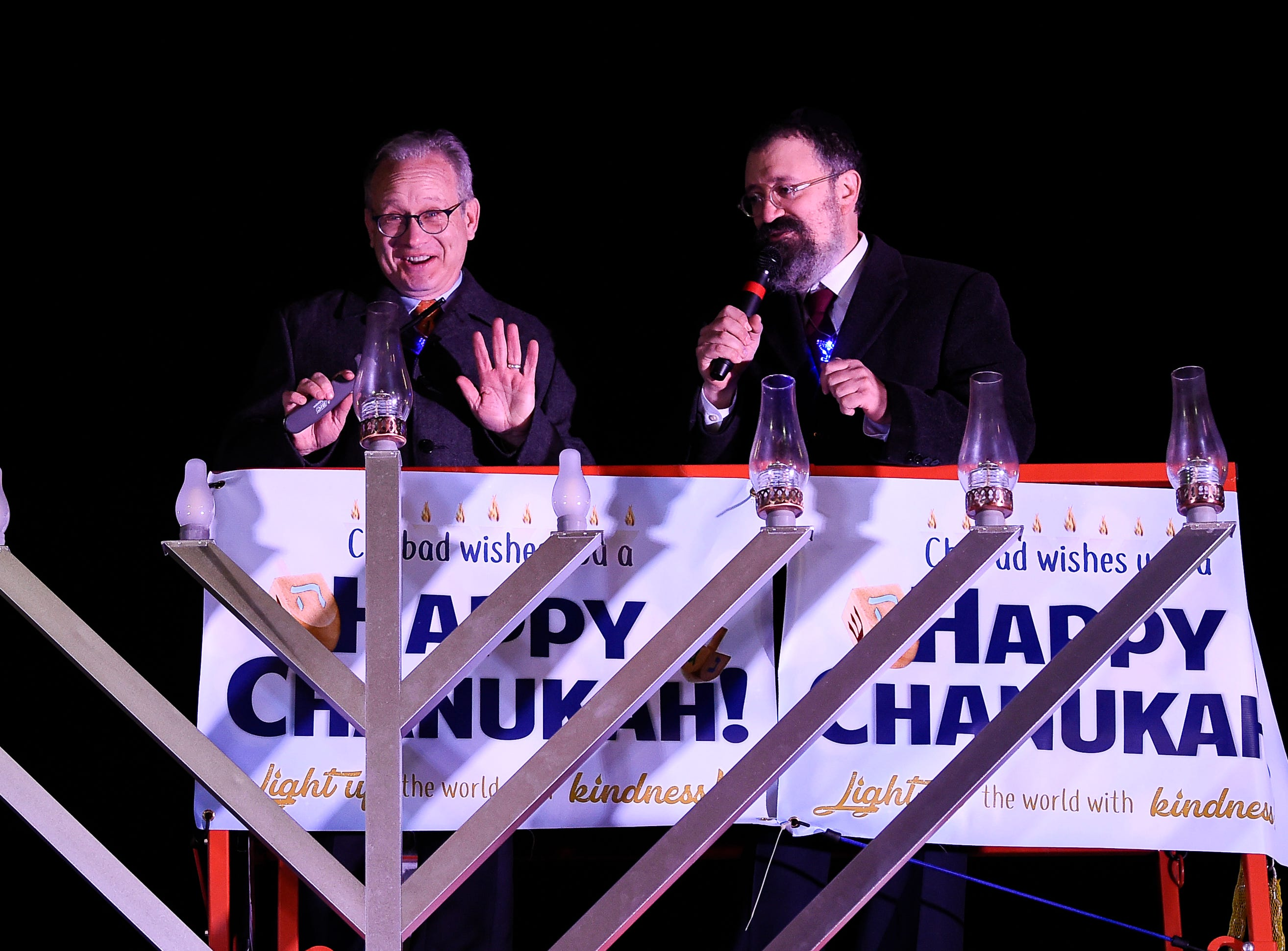 Mayor David Briley and Rabbi Yitzchok Tiechtel prepare to light candles during a Chanukah menorah lighting ceremony at Public Square Park Tuesday, Dec. 4, 2018, in Nashville, Tenn.