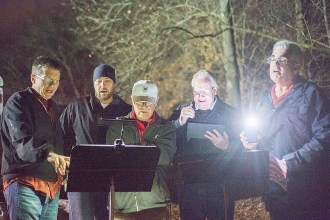 Attendees enjoy stepping back in time for Christmas cheer during Yulefest at Historic Mansker's Station at Moss-Wright Park in Goodlettsville on Saturday, Dec. 1.