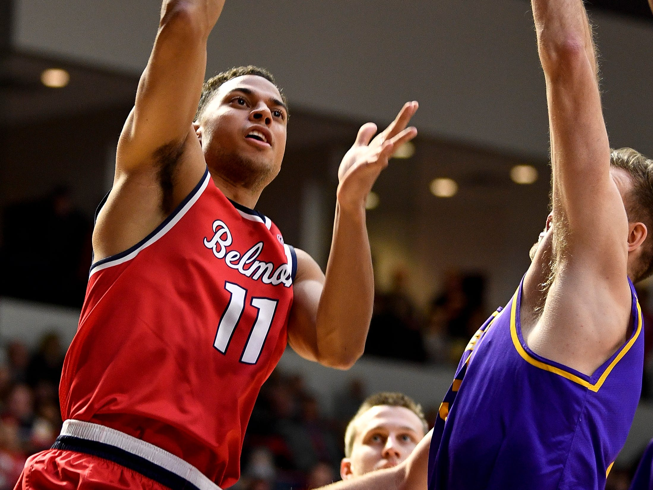Belmont guard Kevin McClain (11) shoots over Lipscomb guard Michael Buckland (3) during the first half at the Curb Event Center in Nashville, Tenn., Tuesday, Dec. 4, 2018.