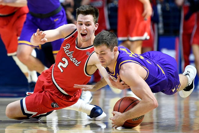 Lipscomb guard Nathan Moran (5) gains control of the ball from Belmont guard Grayson Murphy (2) during the second half at the Curb Event Center in Nashville, Tenn., Tuesday, Dec. 4, 2018.