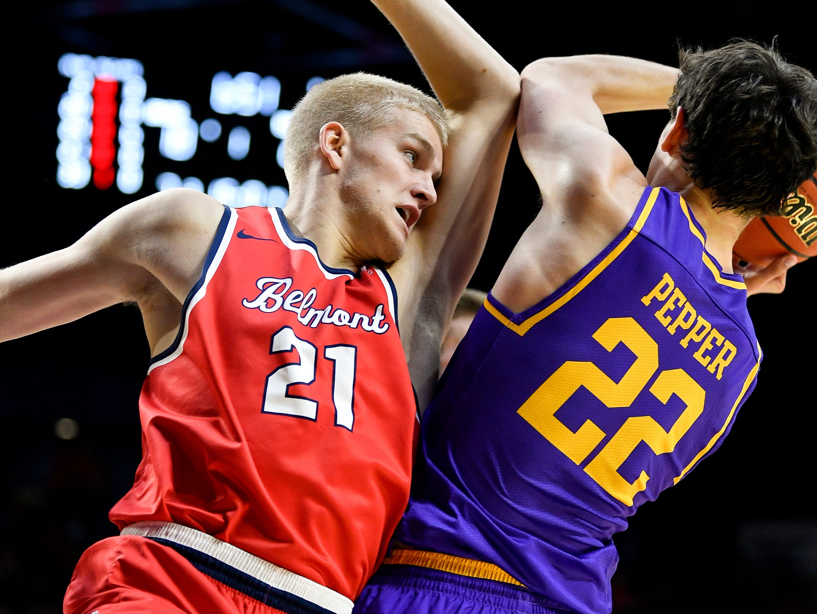 Belmont forward Derek Sabin (21) battles Lipscomb forward Eli Pepper (22) during the first half at the Curb Event Center in Nashville, Tenn., Tuesday, Dec. 4, 2018.