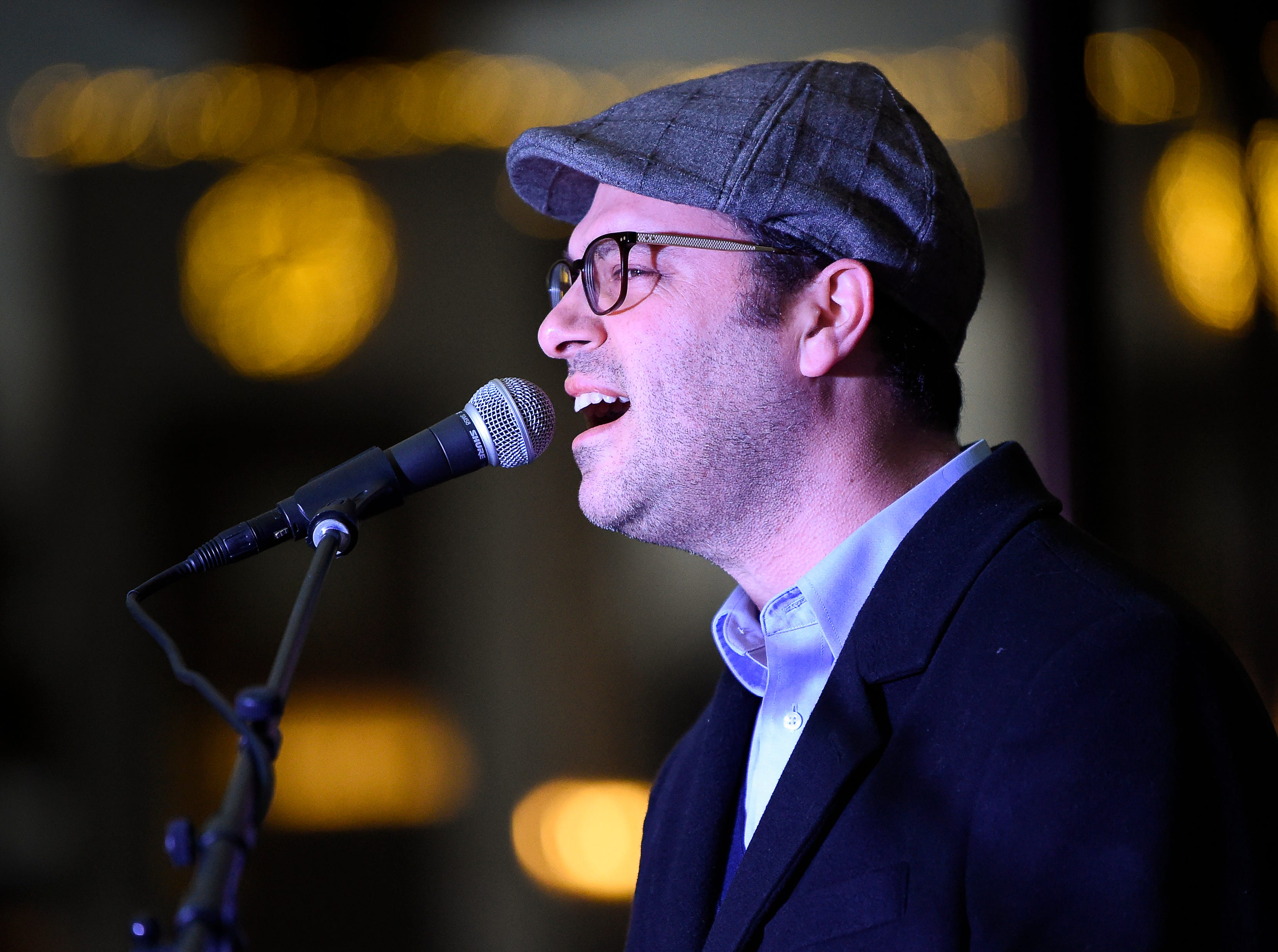 Saul Strosberg performs at the Chanukah menorah lighting ceremony at Public Square Park Tuesday, Dec. 4, 2018, in Nashville, Tenn.