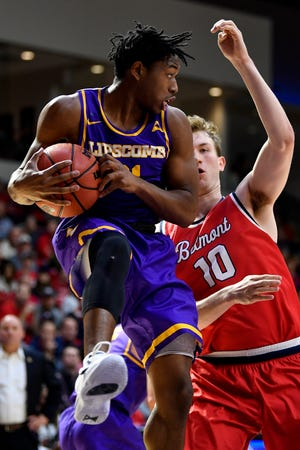 Lipscomb guard Kenny Cooper (21) gains control of the ball against Belmont forward Caleb Hollander (10) during the first half at the Curb Event Center in Nashville, Tenn., Tuesday, Dec. 4, 2018.